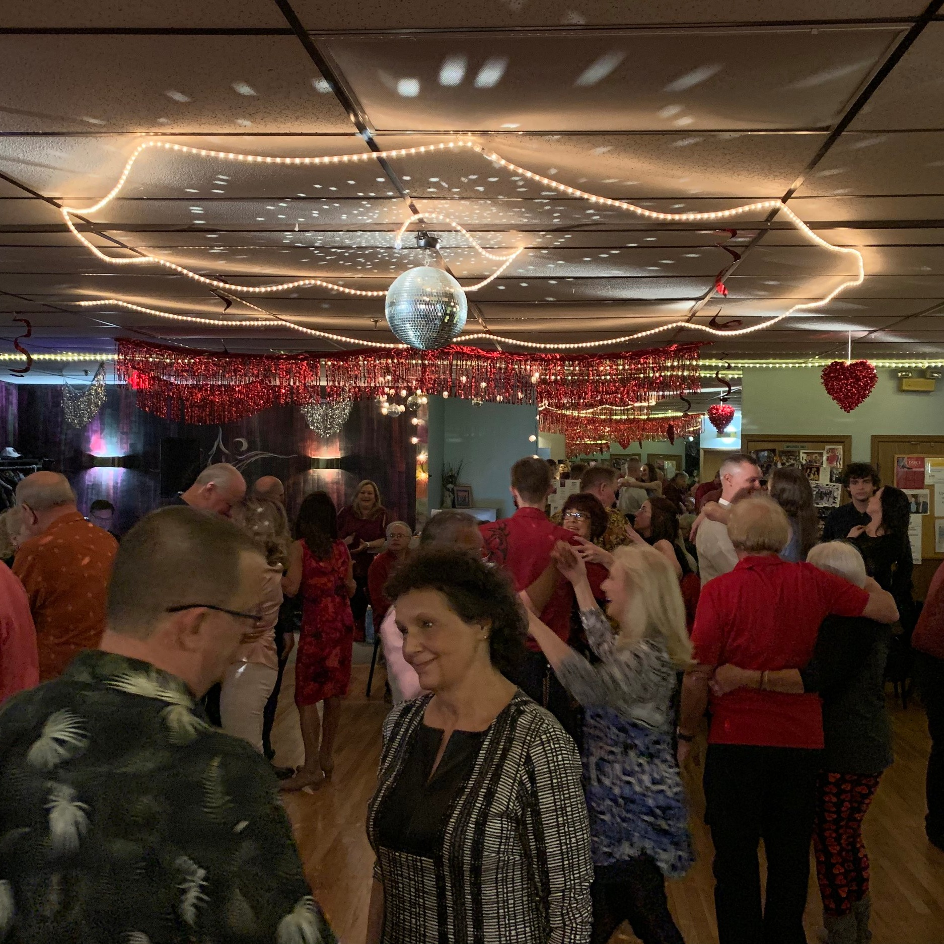 "Practice Session/ Dance Party - -Last, but certainly not least, is the Practice Session/Dance Party. This is an incredibly fun social dance time that allows you to take what you've learned and practice while enjoying complementary refreshments and appetizers in between songs! This time is crucial for learning what dances go with what song and practicing your leading/following skills all while having your instructor right there to help you! We want you to get to know everyone, have fun, switch partners, and feel included in our dance family! We also do theme parties and have exciting live music every single month! Our practice sessions are on Tuesdays following the group class and on the 1st, 3rd, and 5th Fridays of the month following the group class. We want our studio to be a ""club like"" atmosphere that is comfortable for all dancers to enjoy!"