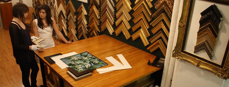 Soho Picture Framing designer discussing fine art custom framing