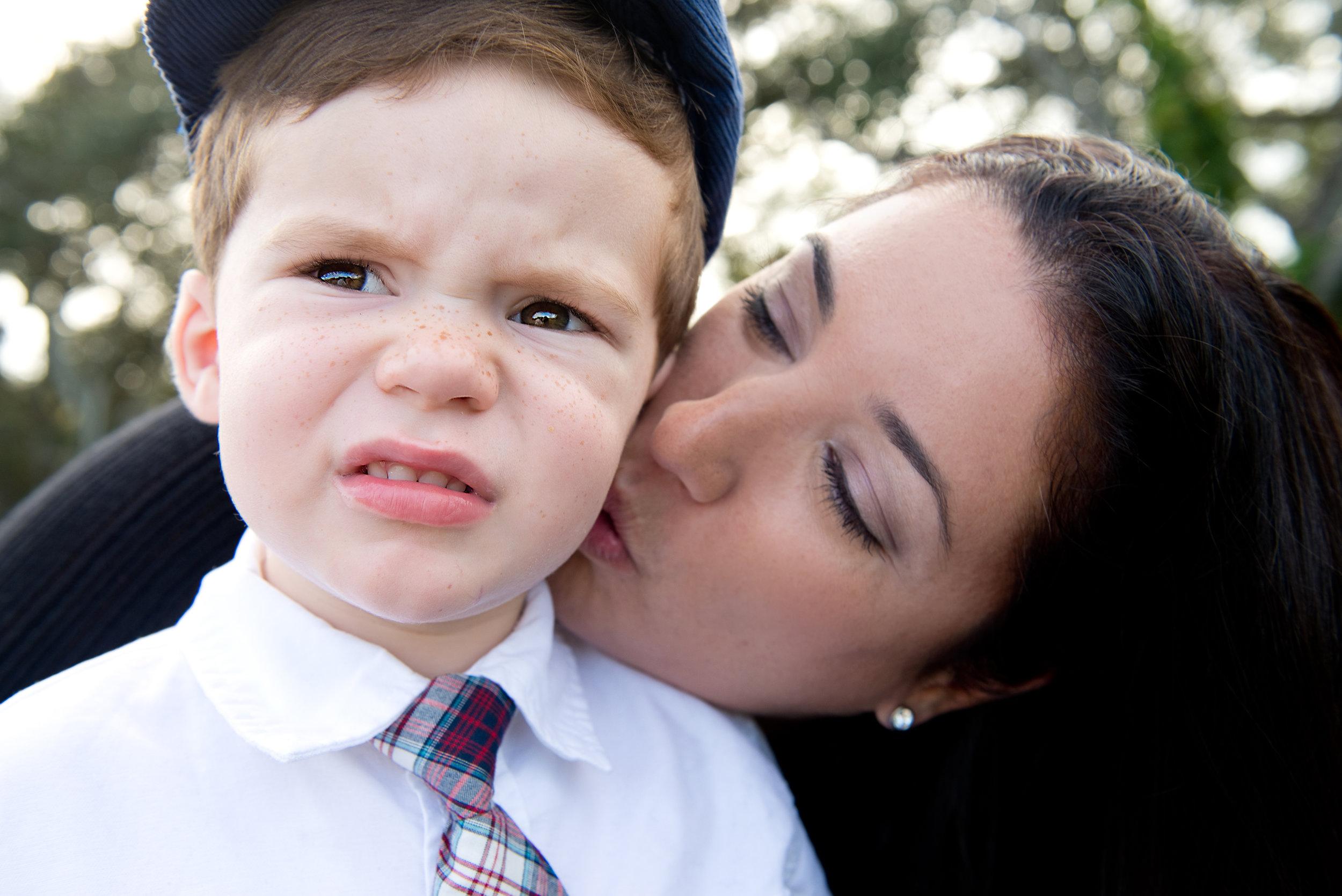Mom Kisses Son - Davie Family Photographer