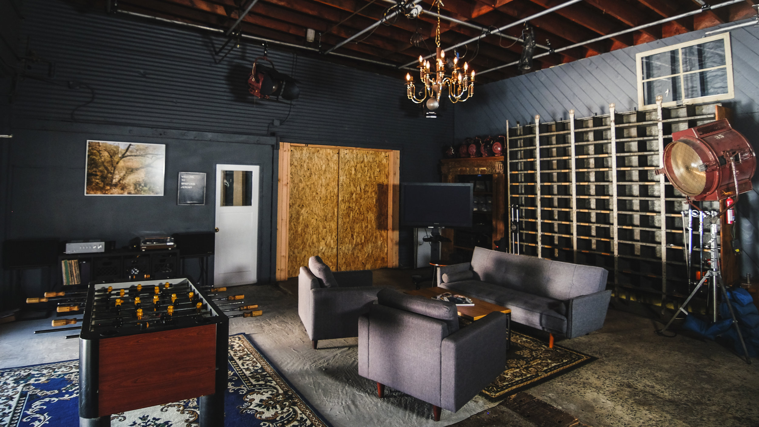 The Lounge/Video Village - (located within main studio)Modern style couch and coffee tableLarge craft bench table on casters2 lounge chairsLarge client monitor