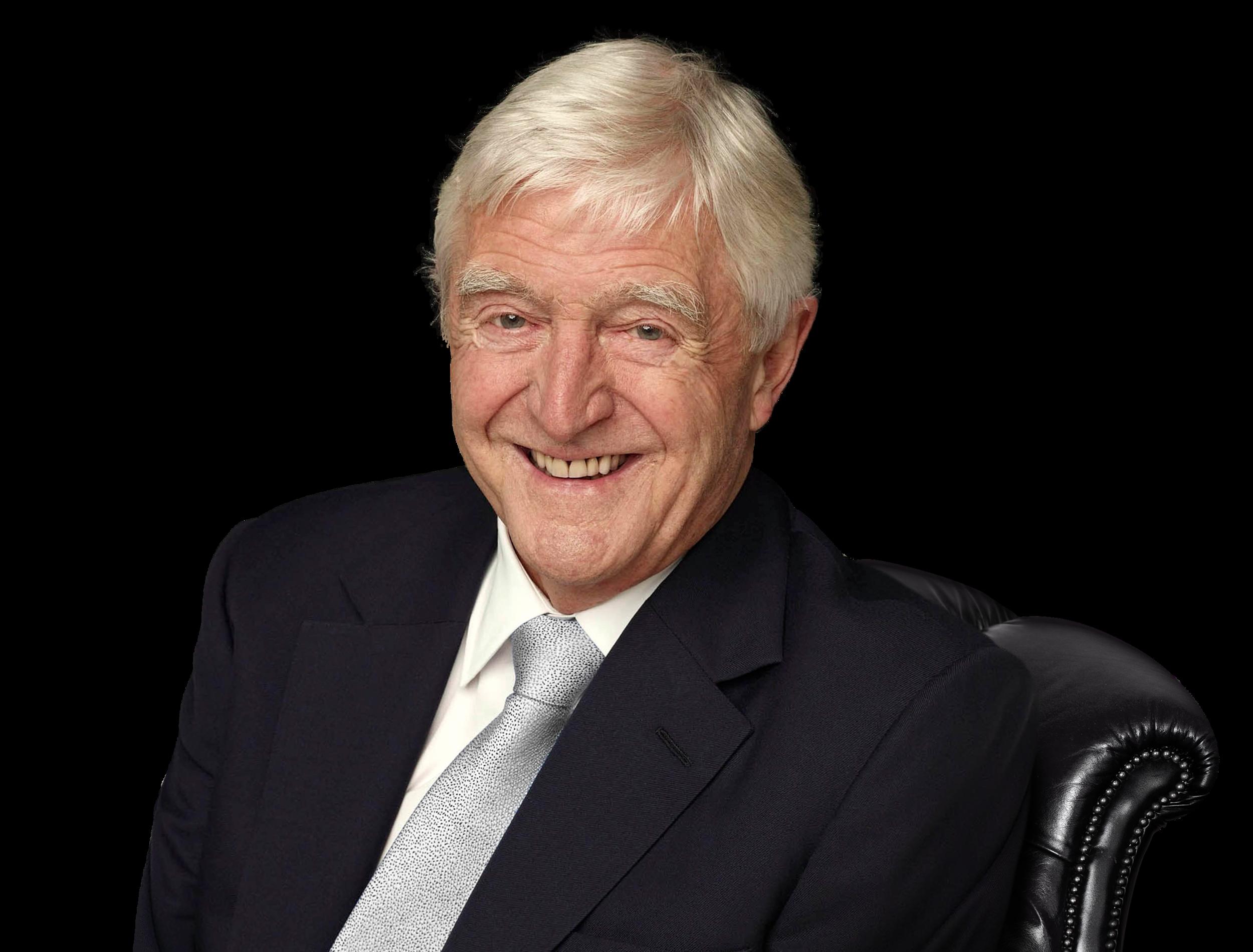 Sir Michael Parkinson sitting in a chair