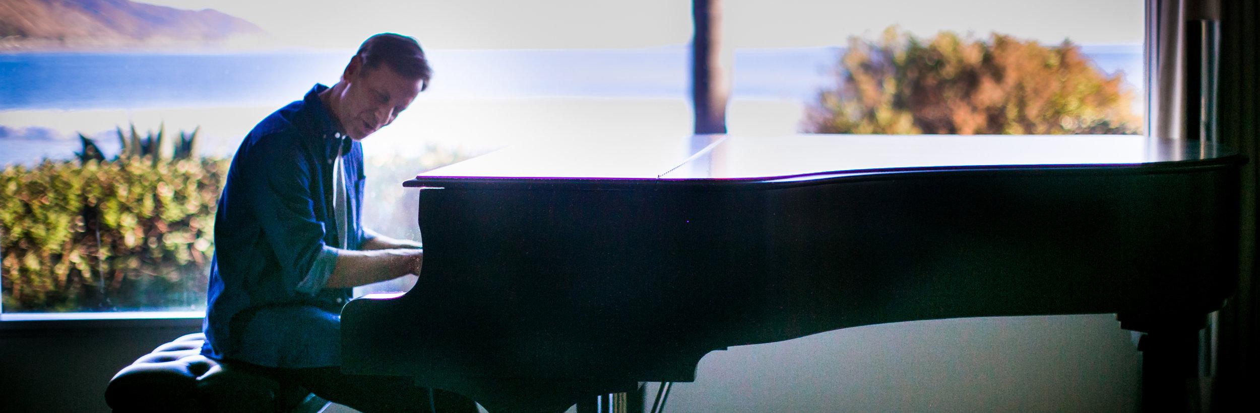 pete bio with piano.jpg