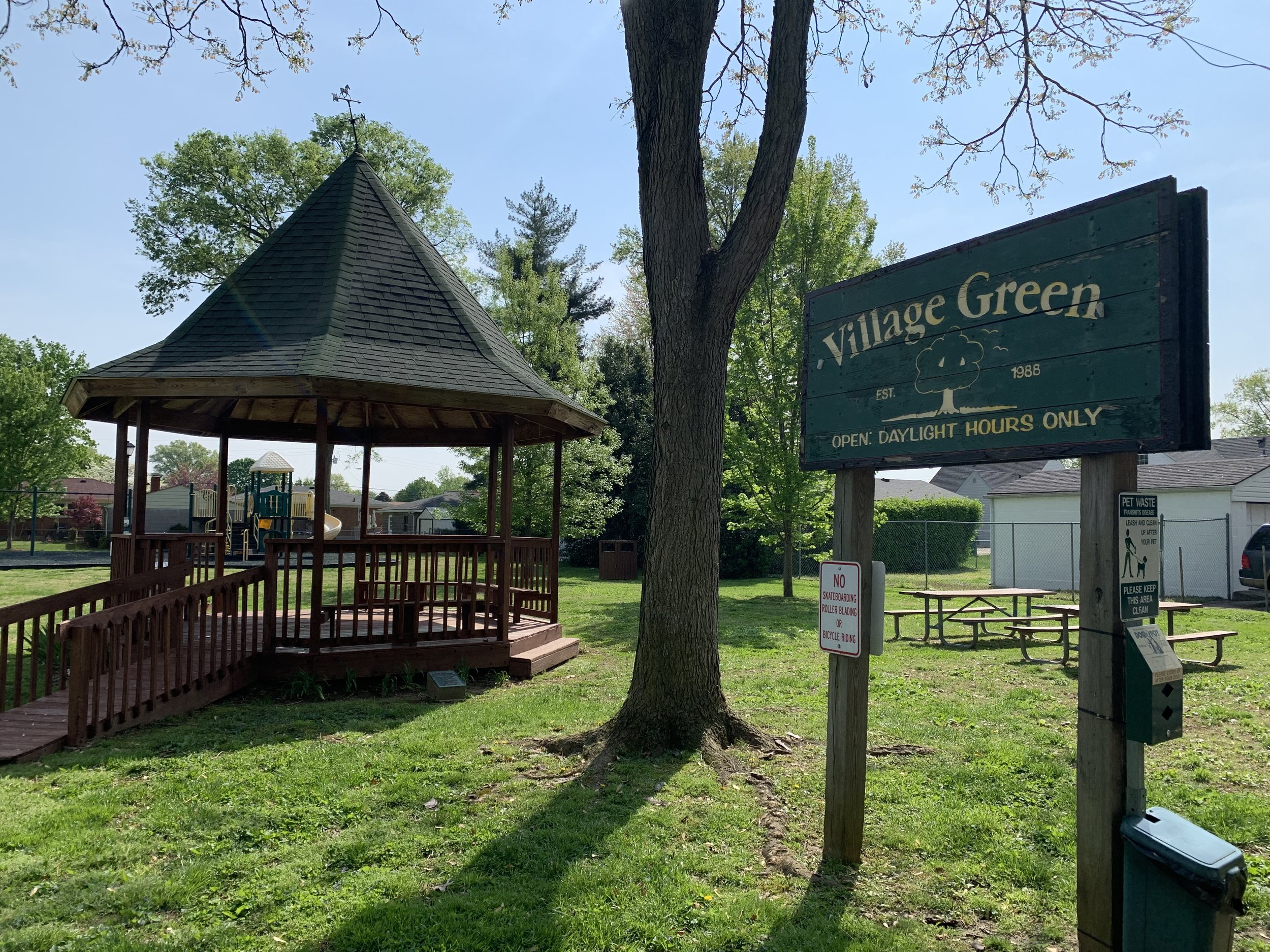The village green park - The Village Green Park is located on Alexander Avenue, between Melford Avenue and Perennial Drive. We have a gazebo, children's playground, picnic tables, and some wonderful green space! The Park is open daily from dawn to dusk.