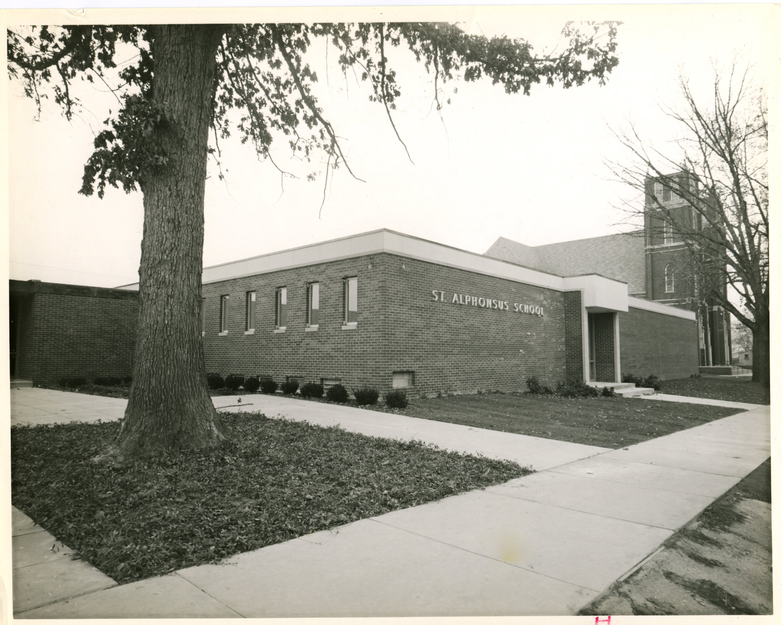 1964 - Enrollment grew to over 900 students and a new 40,000 square foot school building was constructed. The new school had 24 classrooms with approximately 37 students per classroom. The students were taught by 17 Dominican Sisters and 9 lay teachers.