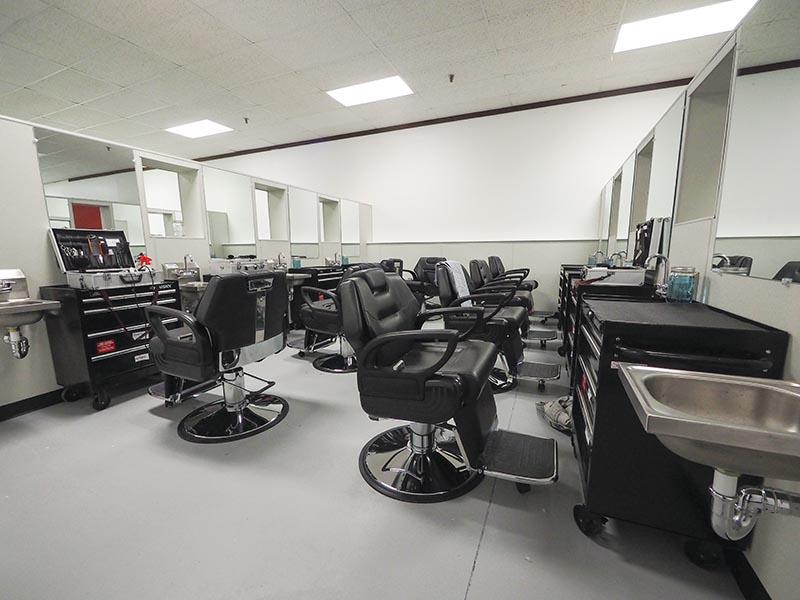 New barber equipment fills the rebuilt cosmetology school facility.