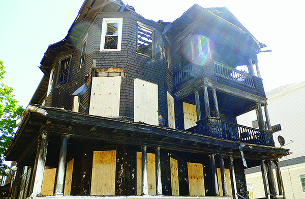 An intense fire completely gutted this three-family home.