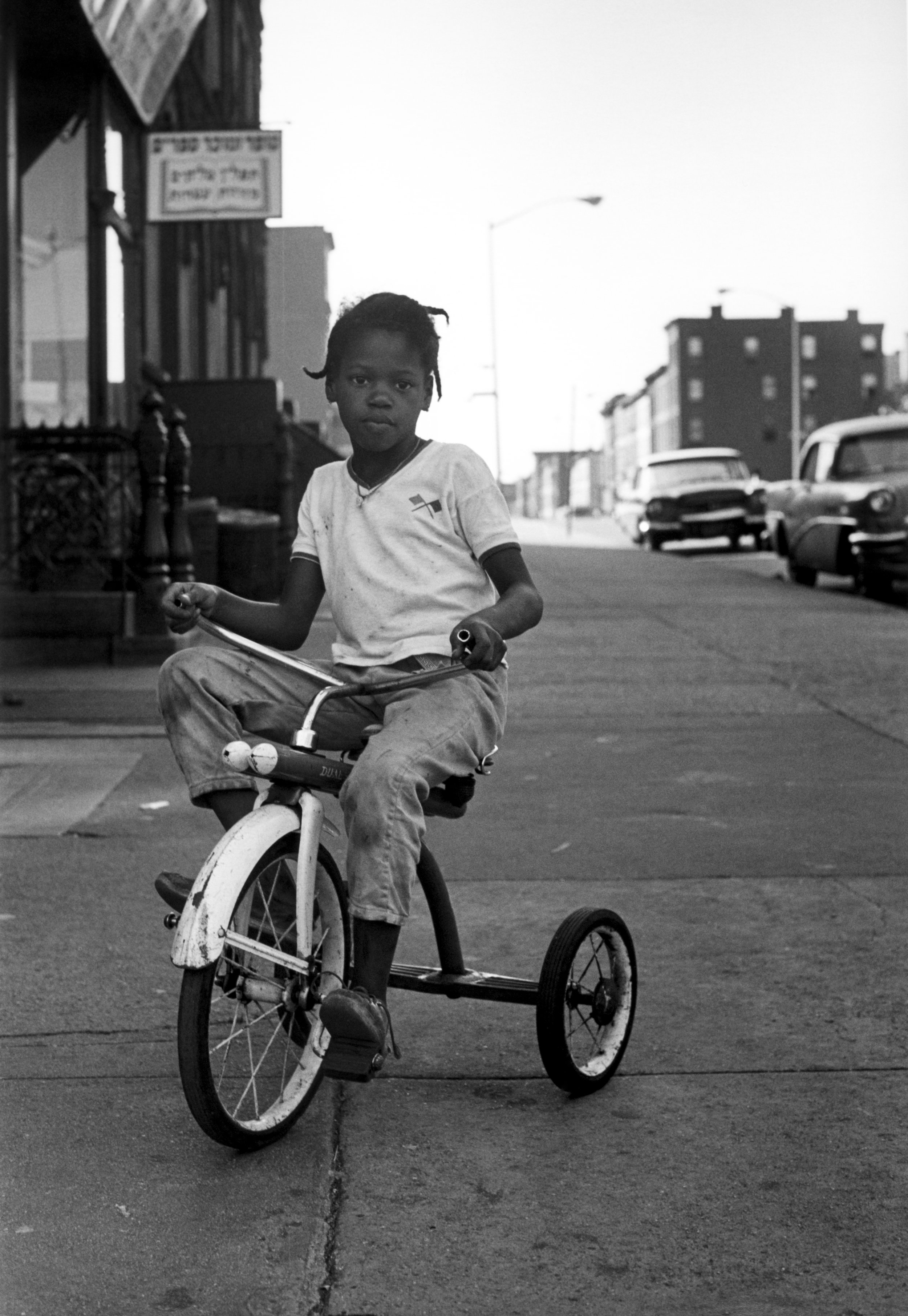 Untitled (girl on tricycle in Crown Heights, Brooklyn), 1962