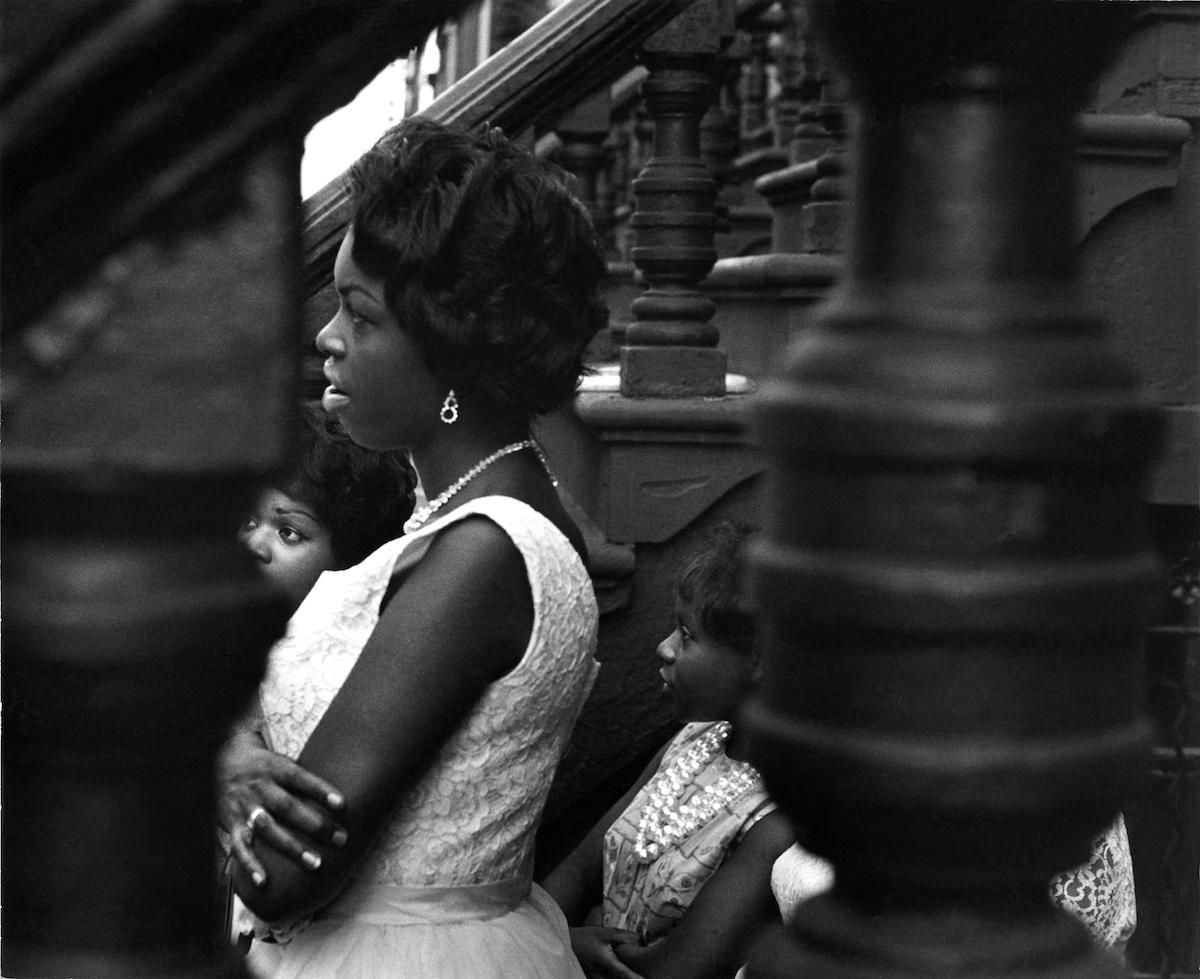 Untitled (woman looking through balustrade), 1963