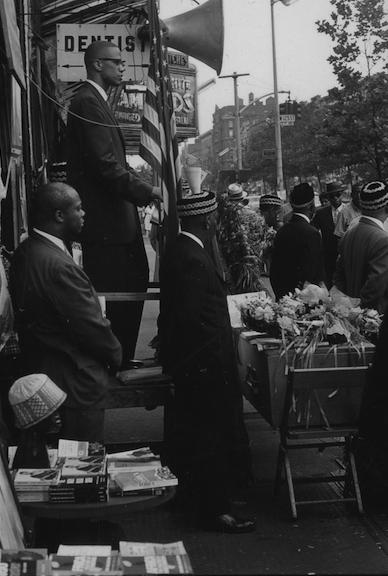 Yoors, Malcolm X speaking at mock funeral for Patrice Lumumba, Harlem, 1963.jpg