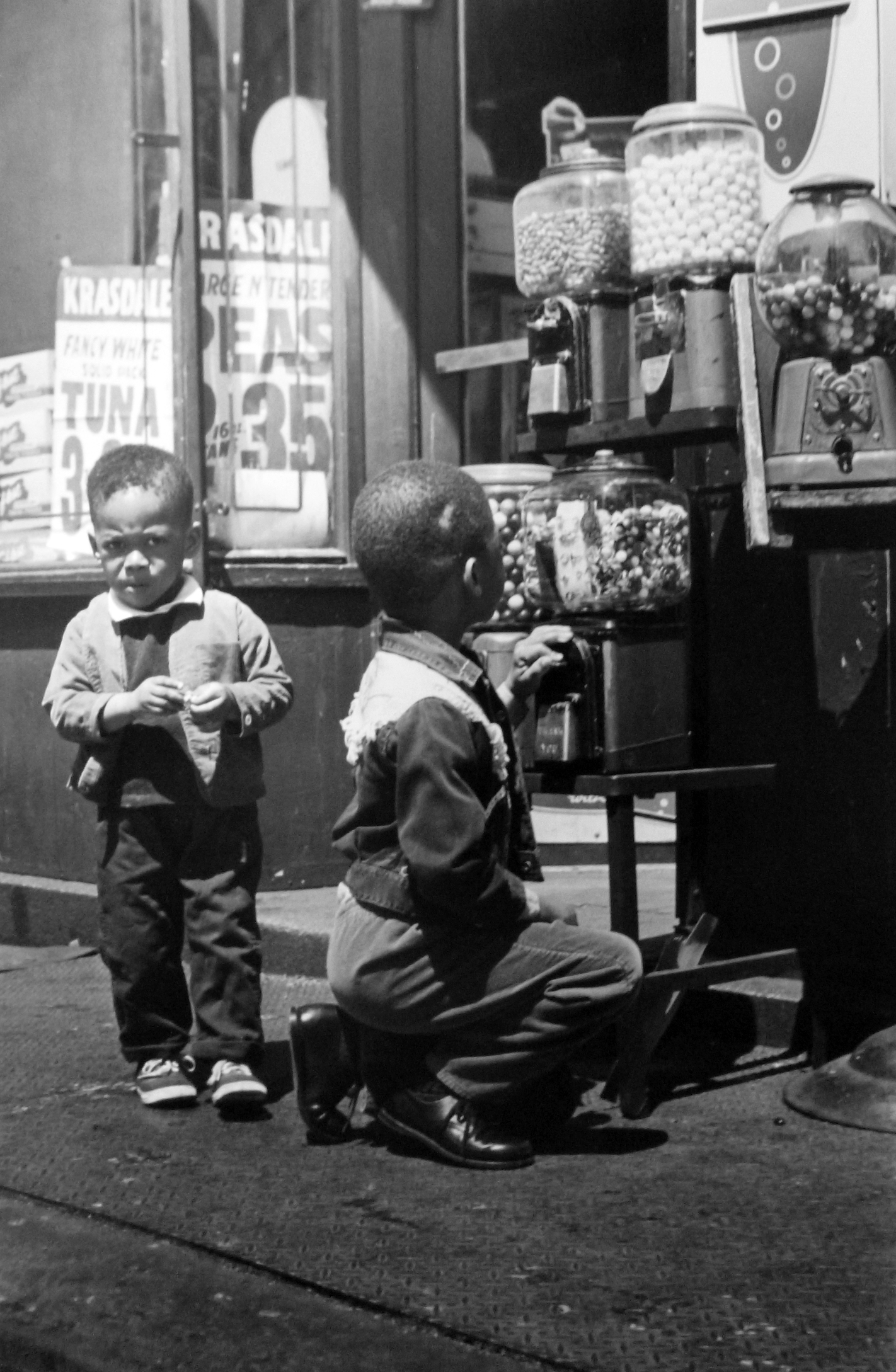 Untitled (boys at gumball machine, Lower East Side), 1961