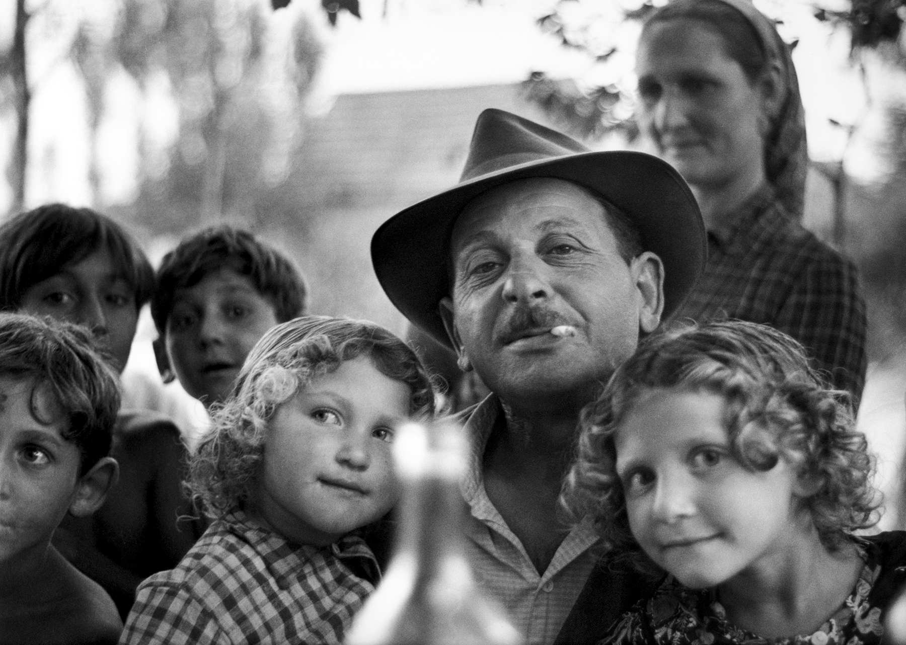 Untitled (Roma man holding children), 1967