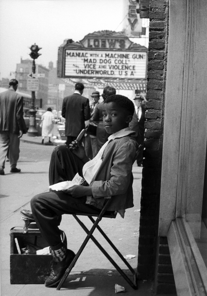 Untitled (shoeshine boy by movie marquee, Delancey Street), 1961