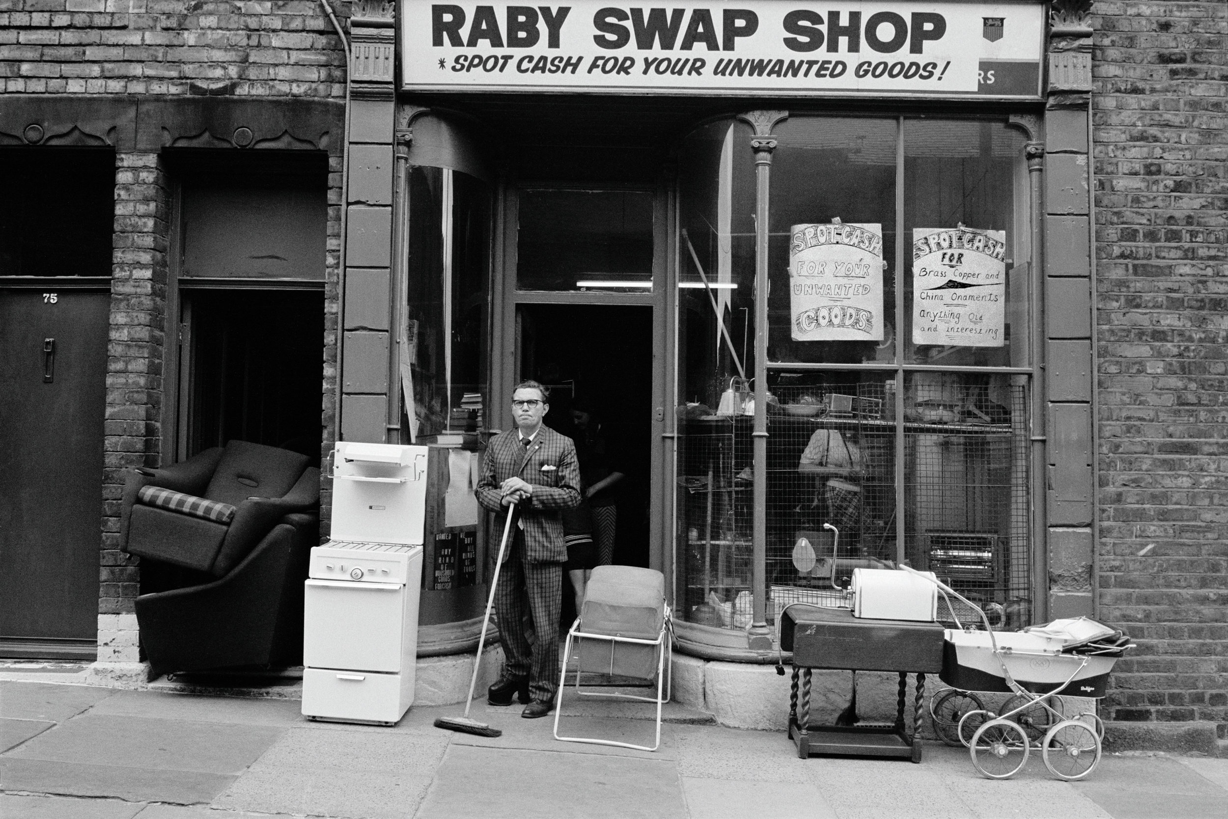 Isaac in Front of His Raby Swap Shop, 1974