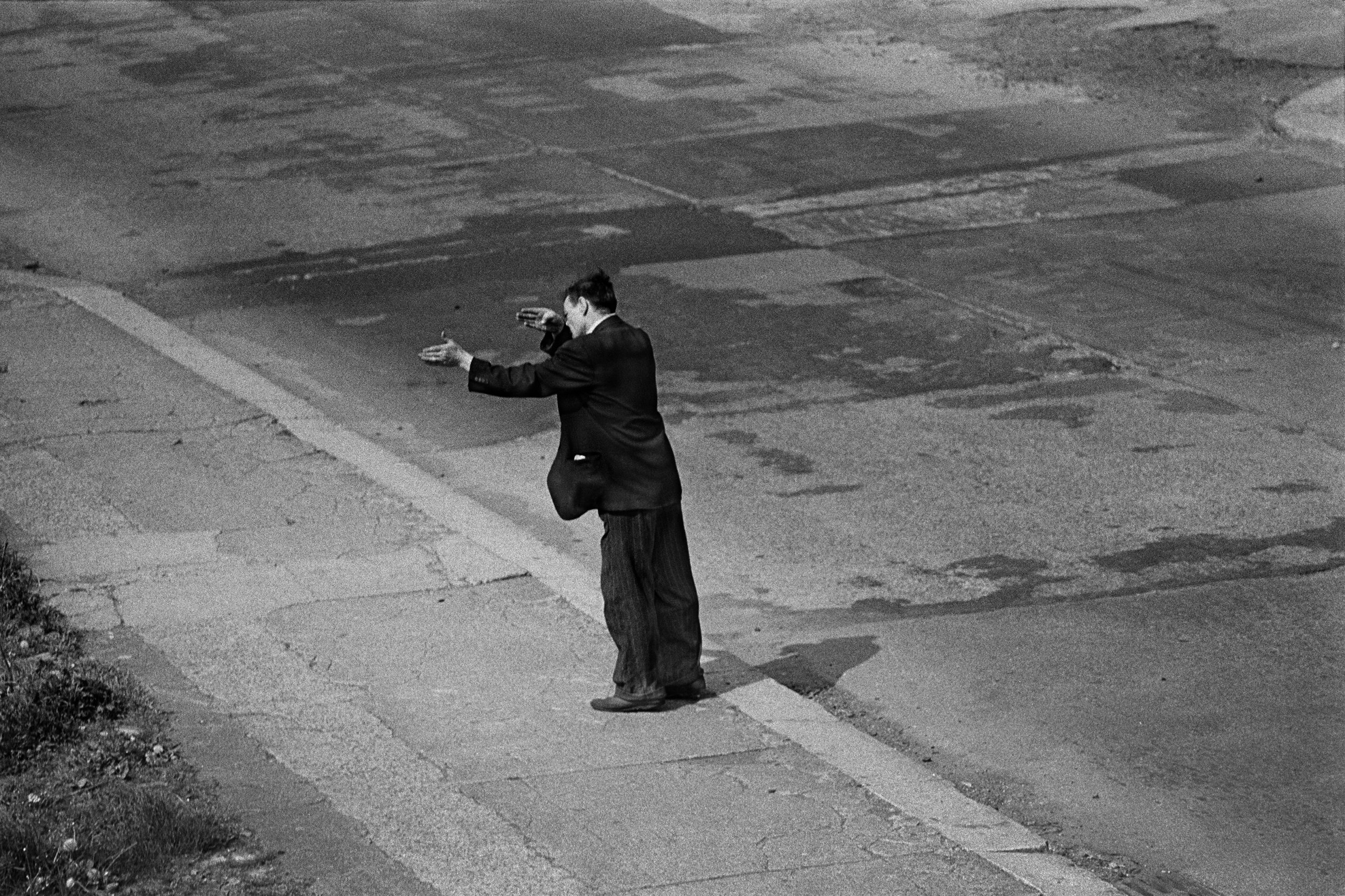 Man Gesturing in Demolished Street, 1971