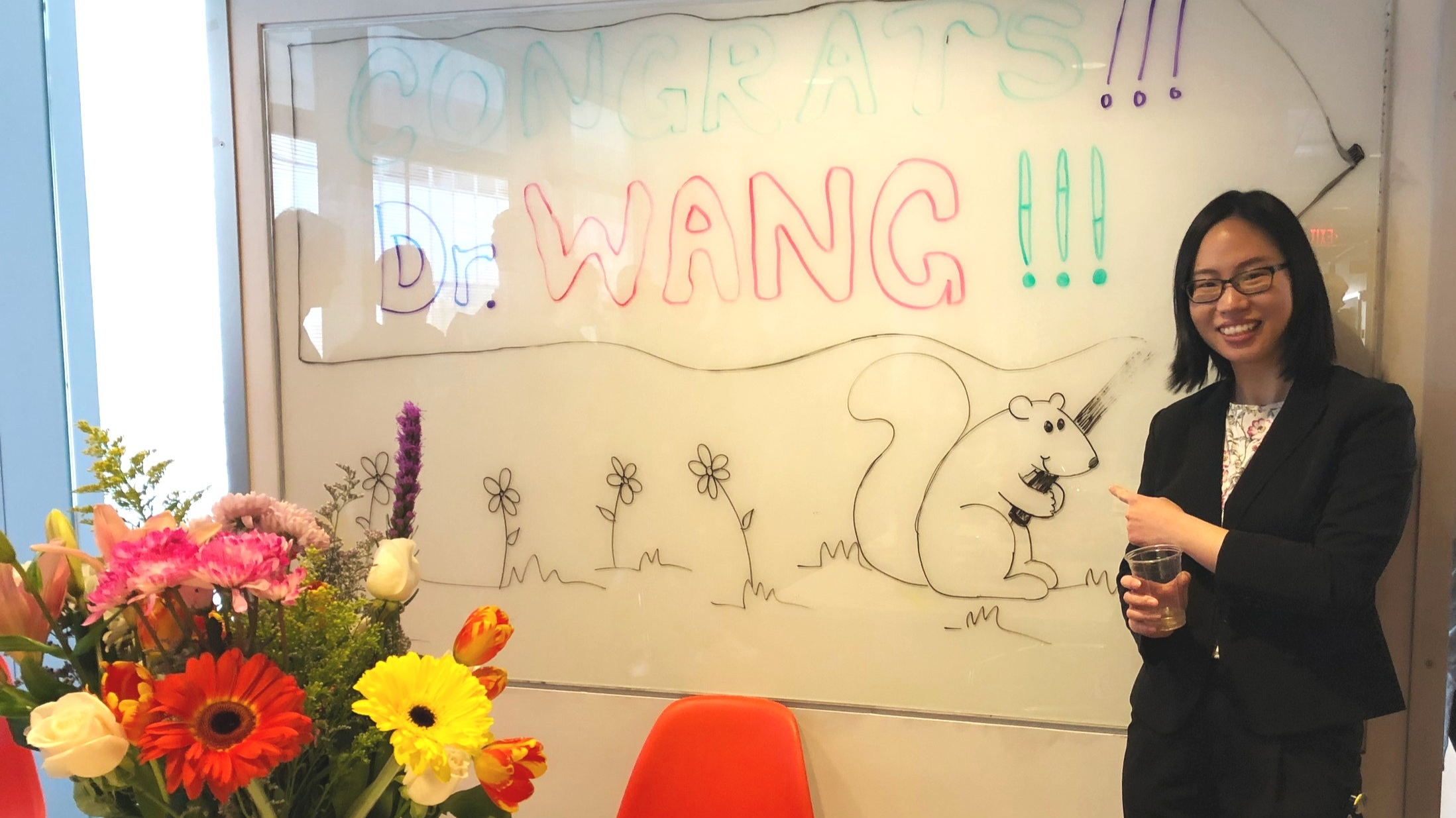 Newly minted Dr. Wang!   In March 2019, student Ruojun Wang successfully defended her thesis work and now has her PhD! After her fantastic presentation, the lab celebrated with lots of food and an adorable squirrel drawn by rotation student Thais Klevorn.