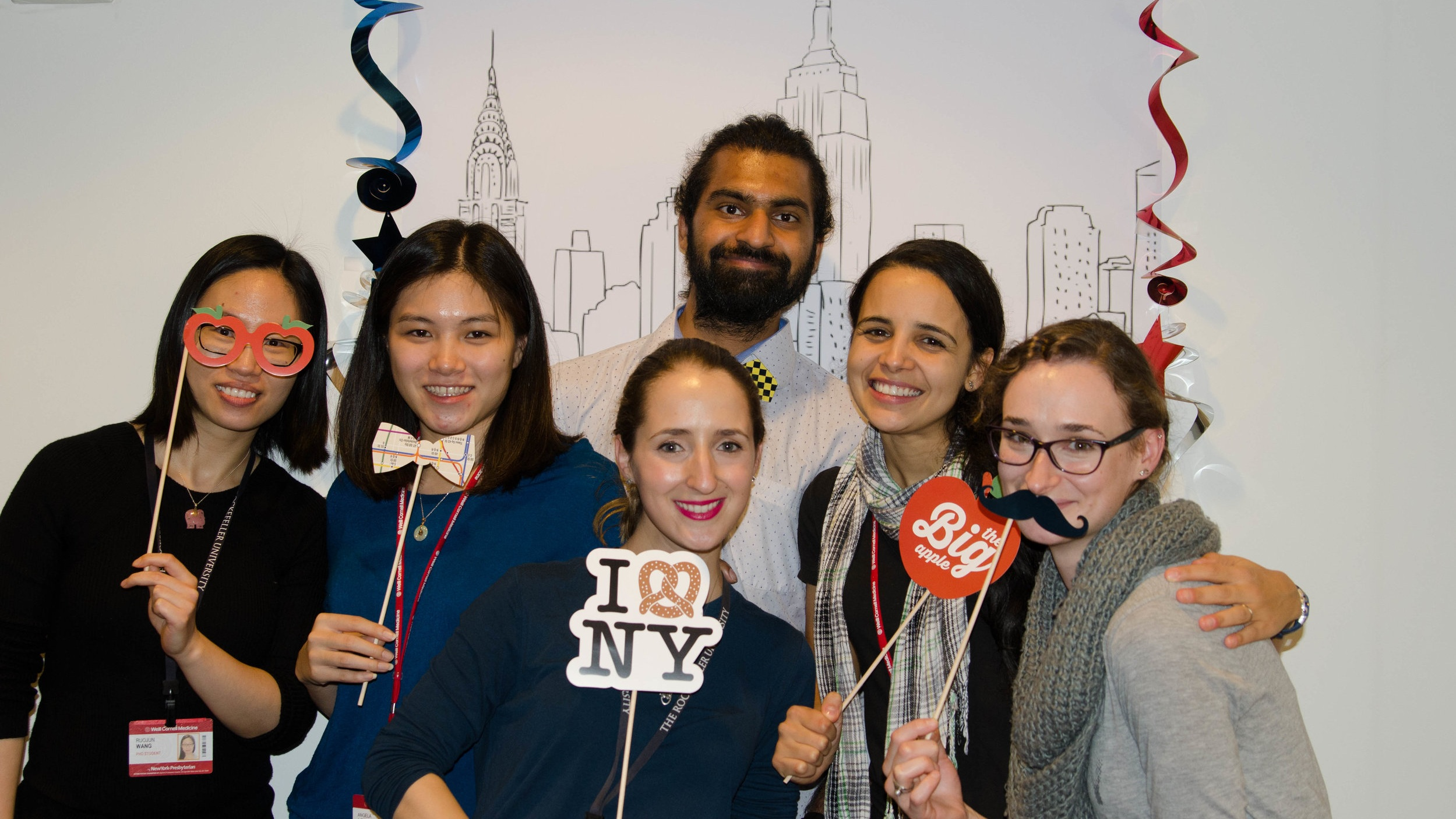 Students at farewell party, Nov. 2018   In November 2018, we bid farewell to some fabulous coworkers who were all moving to new cities. We celebrated our time with them with a NYC-themed photobooth. Wishing them all well in their labs!