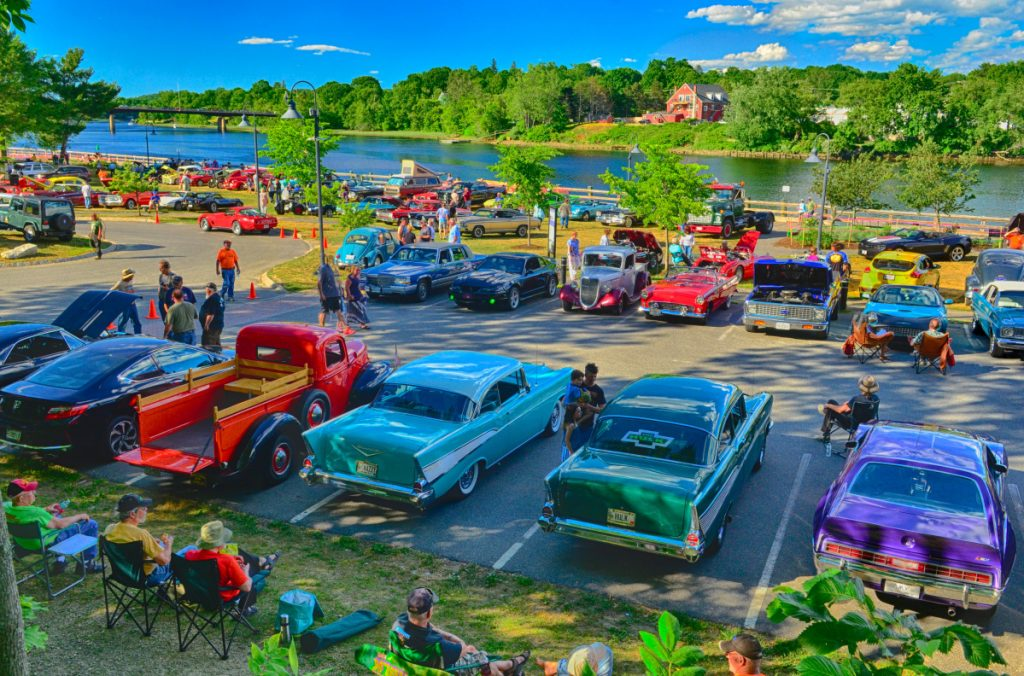 People check out cars lining the banks of Kennebec River during the Cruise In event on Thursday at the Gardiner Waterfront Park.  Staff photo by Joe Phelan, Kennbec Journal.