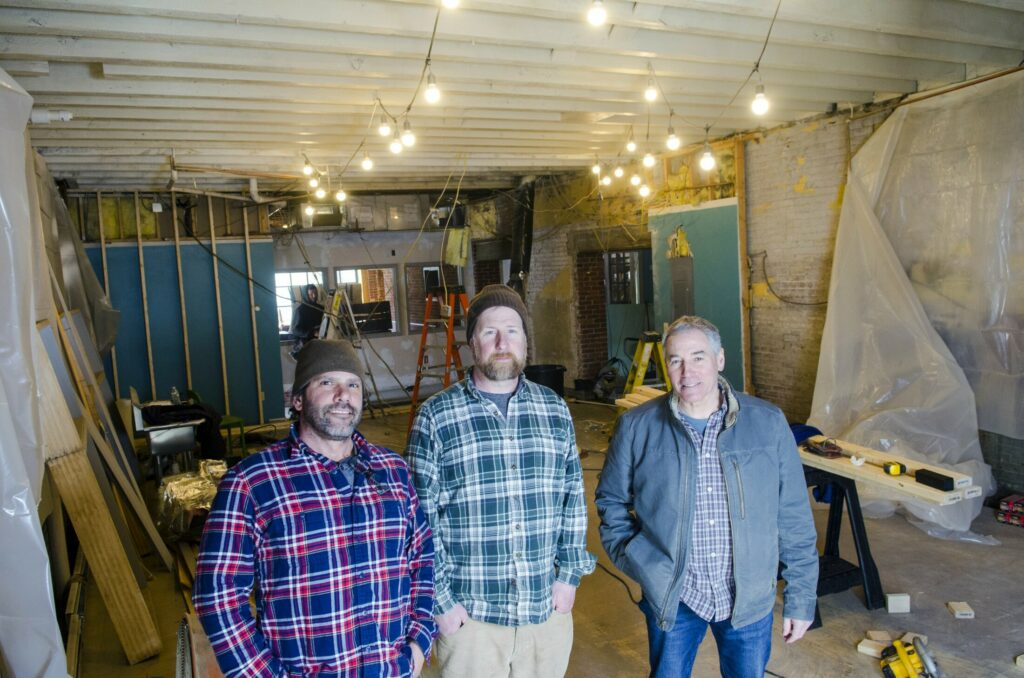 Co-owners Matthew Kendall, Steve Sommers, and Steve Casey in what will be the brew room of Bateau Brewing in Gardiner. Staff photo by Joe Phelan