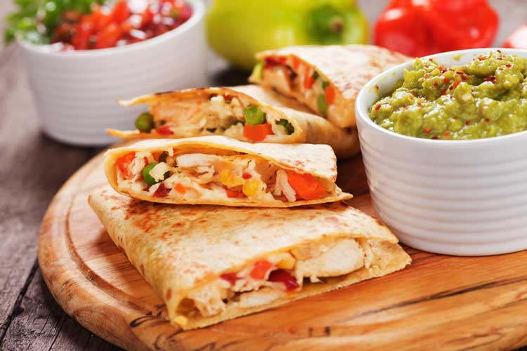 HOT CHARLIE'S™ HOT SAUCE QUESADILLA - INGREDIENTS2 c. shredded rotisserie chicken4 oz. cream cheese, softened1/2 c. ranch dressing, divided1/4 c. + 2 tbsp. Hot Charlie's™ Hot Sauce2 tbsp. Sliced green onions1/2 c. shredded gouda1/2 c. Shredded Monterey Jackkosher saltFreshly ground pepper4 medium flour corn tortillasvegetable oilINSTRUCTIONSMake the filling. In a medium bowl, combine chicken, cream cheese, 1/4 cup ranch, 1/4 cup Hot Charlie's™ Hot Sauce and a tablespoon of green onions. Stir until well combined. Season to taste with salt and pepper.Place a large skillet over medium heat and pour enough oil to coat the bottom. While the oil is heating, build the quesadillas. Spread the Hot Charlie's™ Hot Sauce mixture onto a tortilla. Top with both cheeses and cover with a second tortillas. Repeat to make another quesadilla.Working one at a time, transfer a quesadilla to the skillet. Cook until golden-brown, about 3 minutes. When ready to flip, cover the pan with a large plate. Invert pan to transfer the quesadilla onto the plate, then slide the quesadilla back onto the pan (golden side up). Cook until golden-brown. Repeat process with other quesadilla.Drizzle with more ranch dressing and Hot Charlie's™ Hot Sauce. Garnish with more scallions.