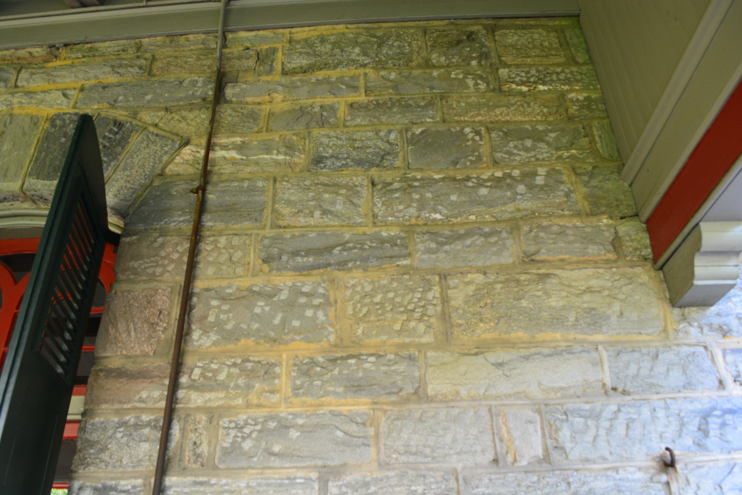 The chisel marks on the stone exterior have been protected by the porch awning for almost a hundred and twenty years.
