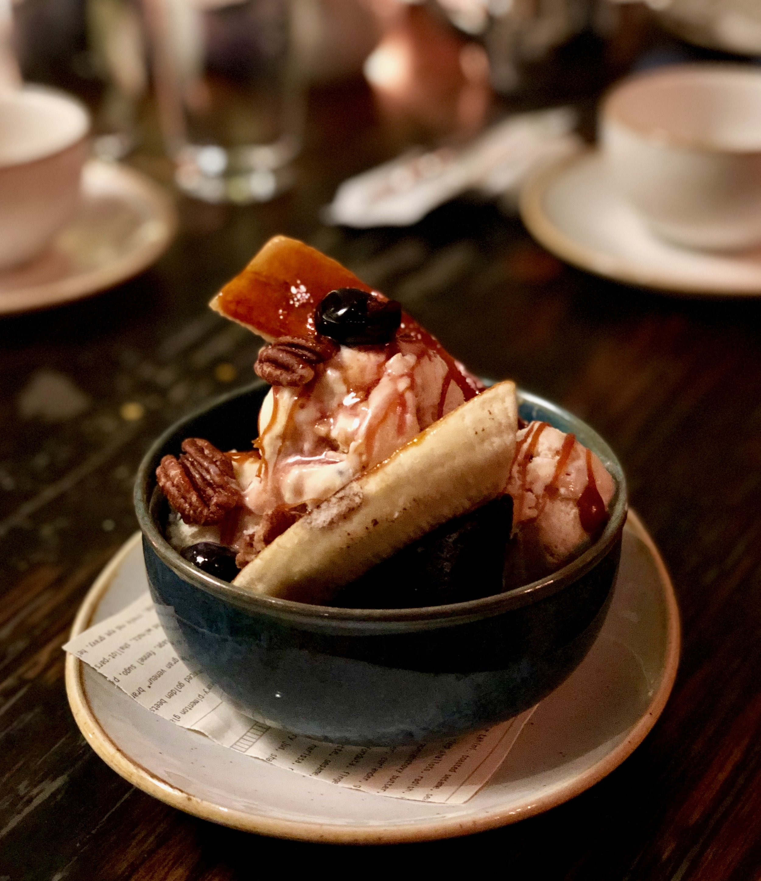 Brûléed Banana Split, tin roof ice cream with peanuts, chocolate brownie, candied pecans, caramel sau