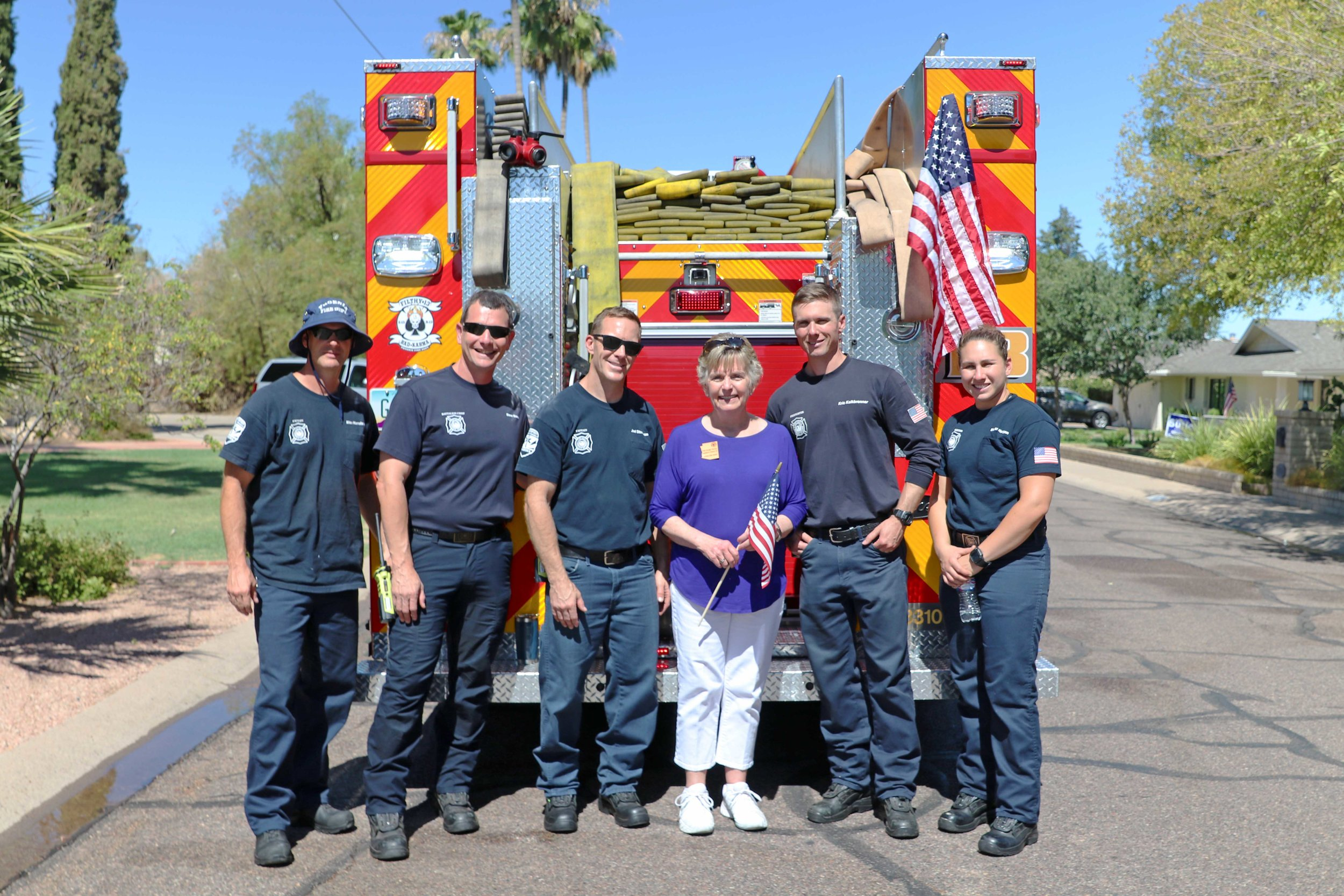 Kate With Firefighters.jpg