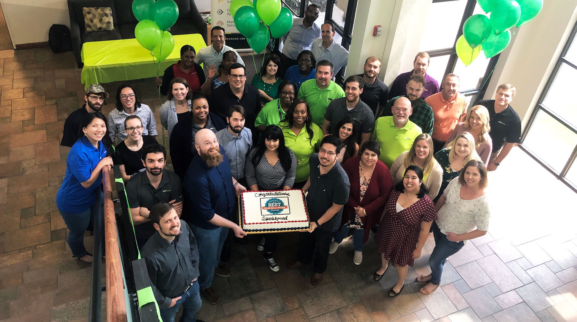 A group of Sparkies in the Baton Rouge office celebrate being awarded 2019 Best Places to Work