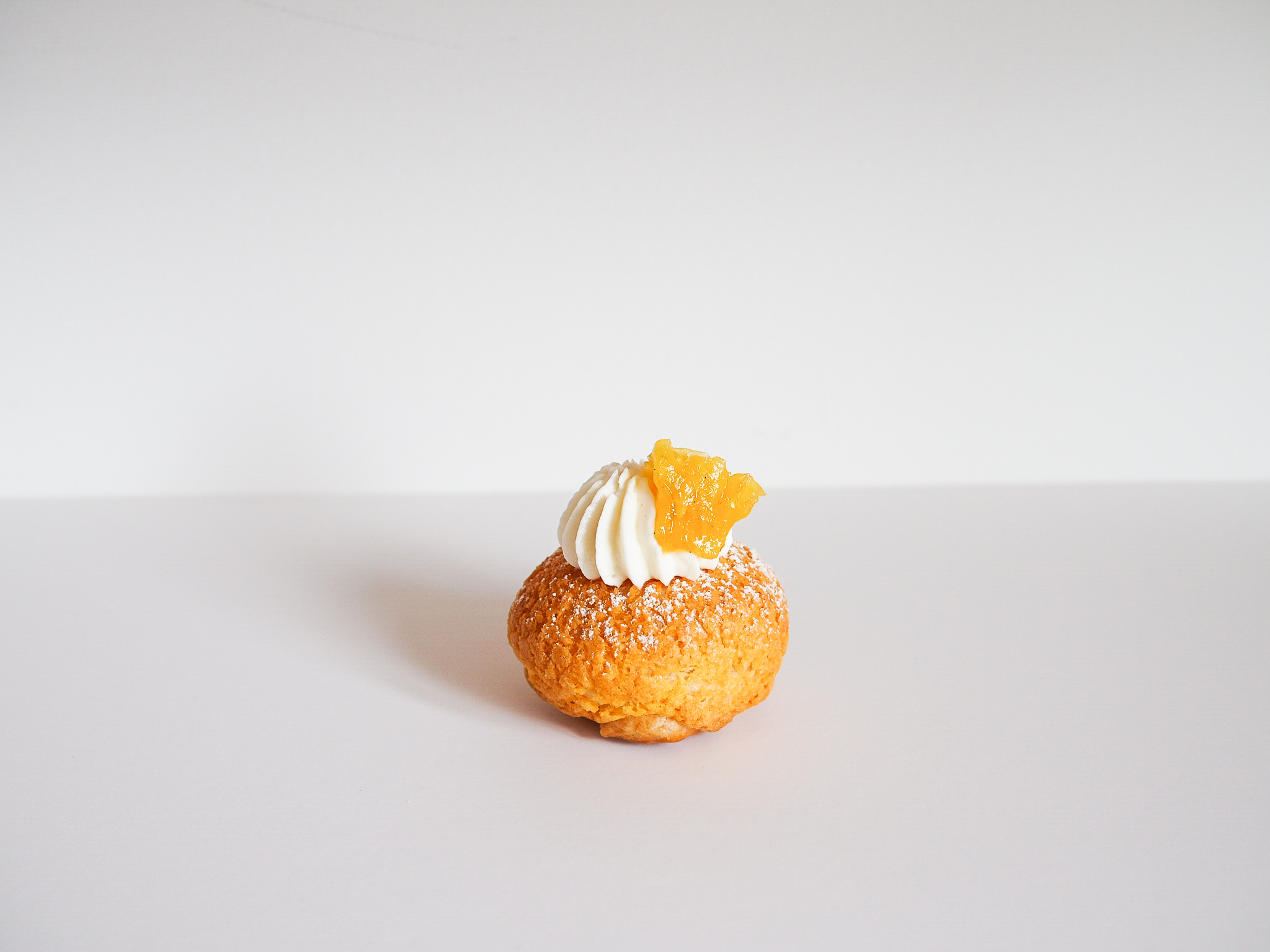 Pineapple Cake - tropical + lightfilled with a whipped white chocolate infused with pineapple, filled with pineapple jam, topped with powdered sugar and topped with a candied pineapple
