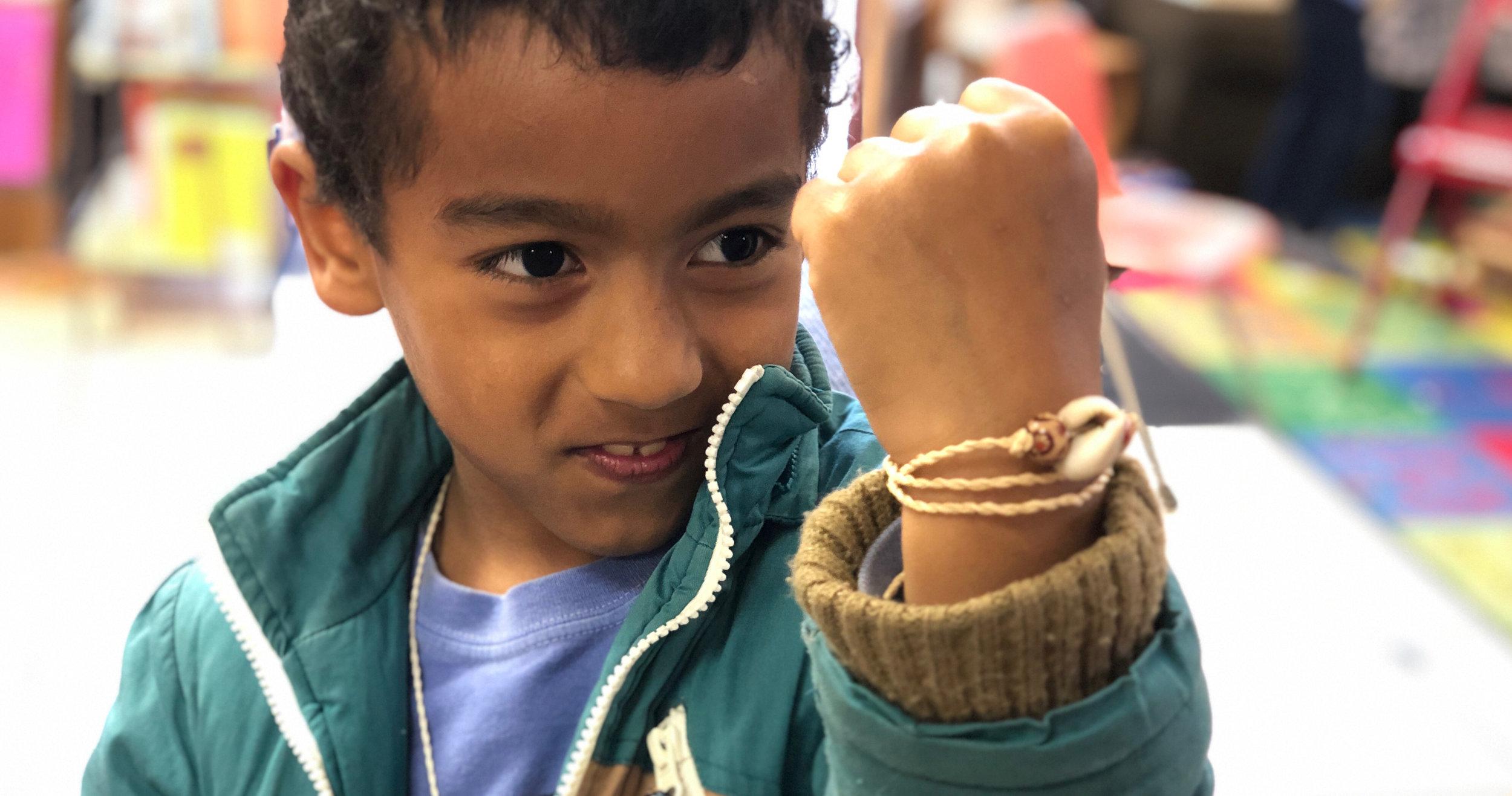 Proud of his cordage bracelet!