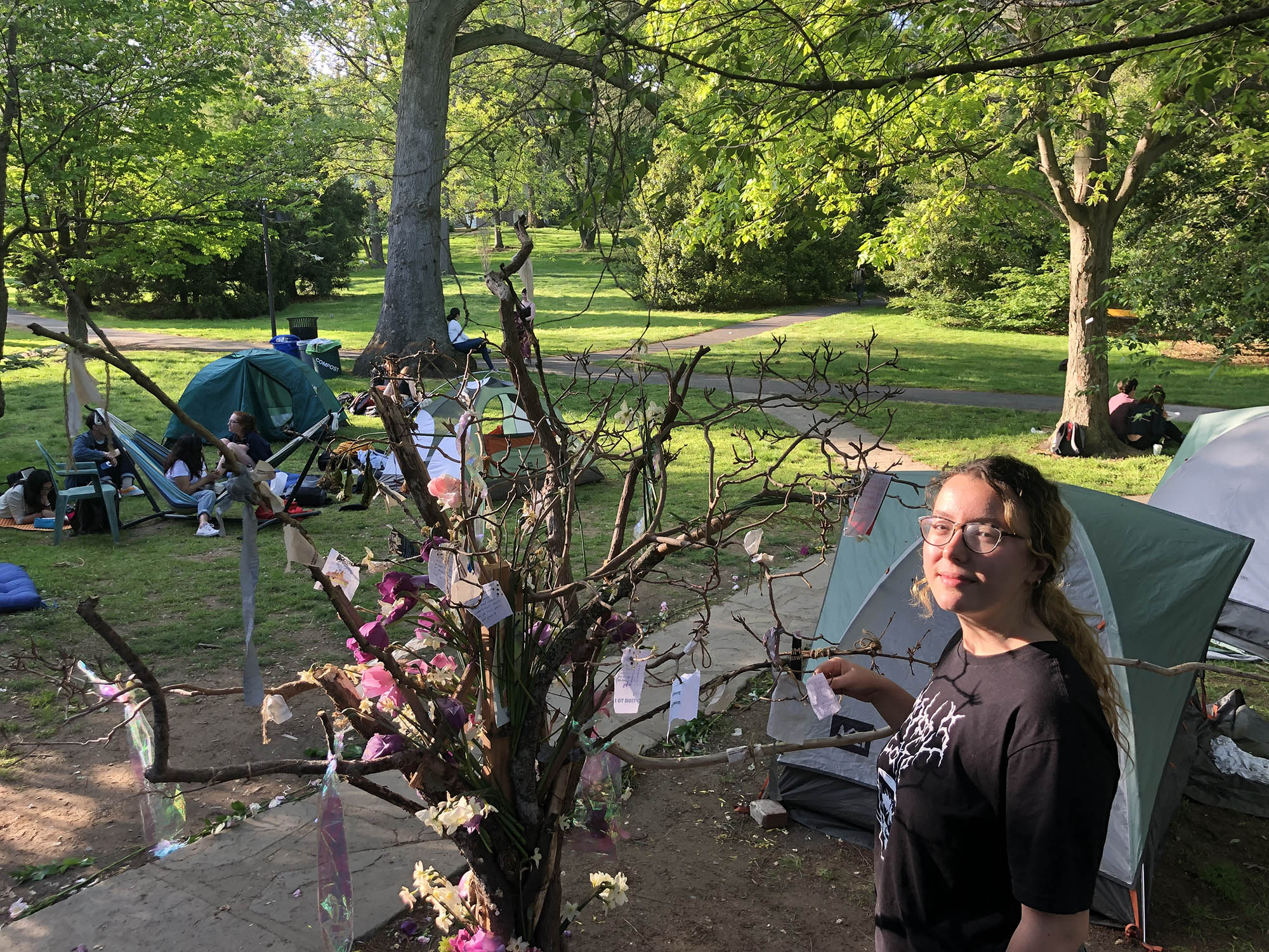 "At the protest's ""wishing tree"" outside the Phi Psi fraternity house, ideals remain the focus of Daria Mateescu, one of the Psi sit-in organizers. She spoke Tuesday at the house which some participants continued to occupy, both indoors and on the adjacent lawn on Swarthmore's lower campus."