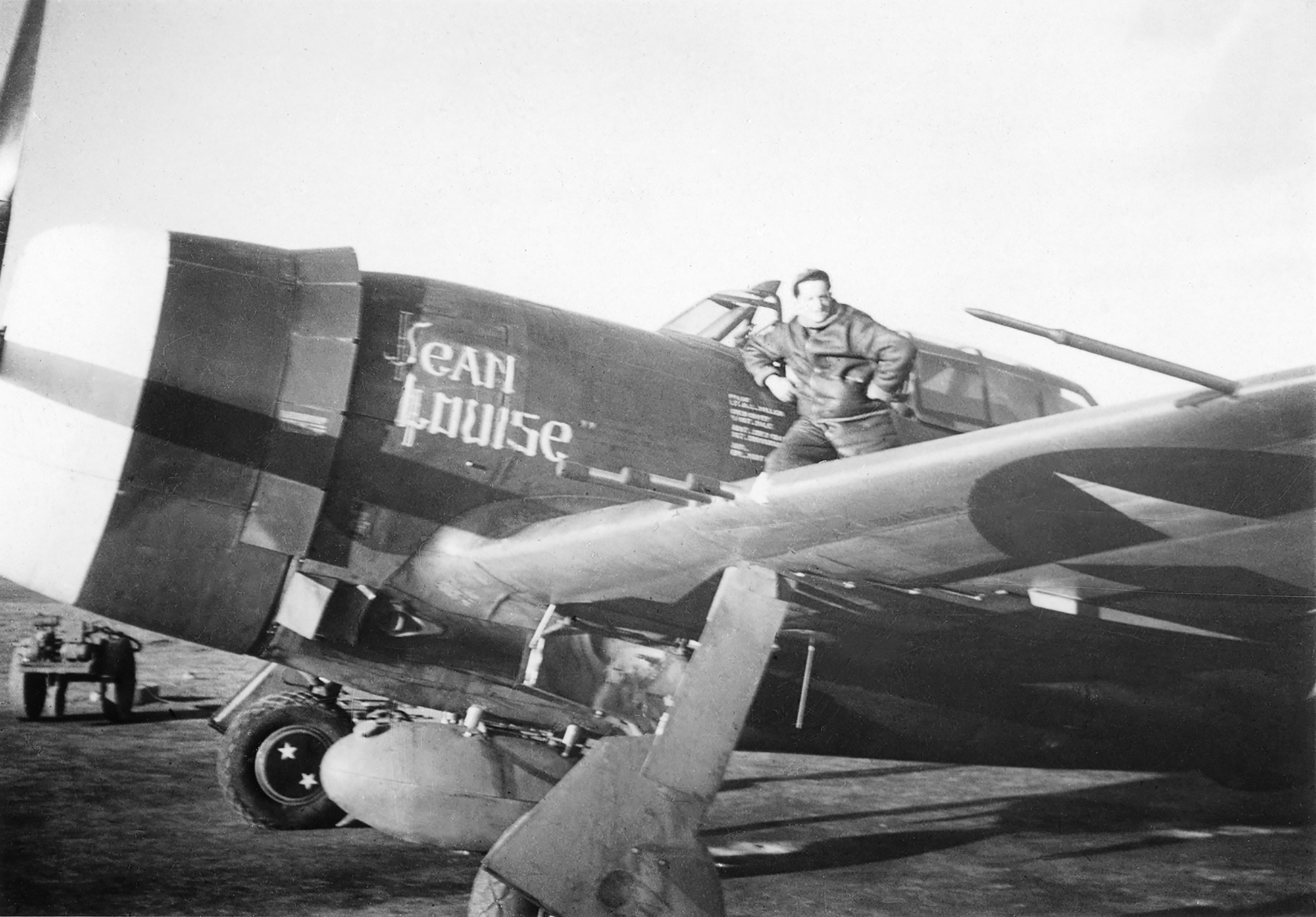 "Harry's P-51 Mustang, ""Jean Louise,"" with an Army Air Corps buddy at the cockpit."