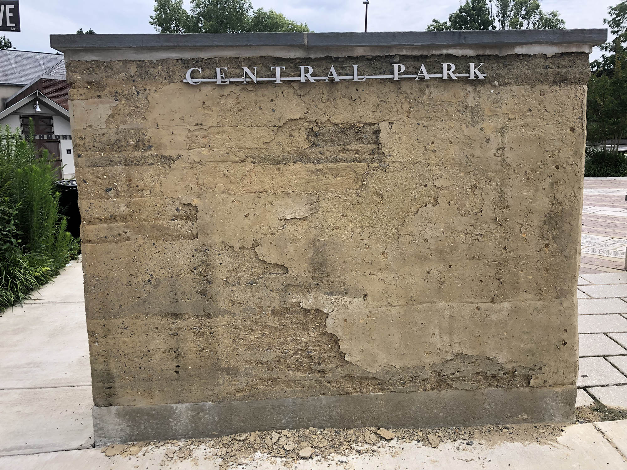 """Crumbling infrastructure: The """"rammed earth"""" walls installed in 2016 in Swarthmore's Central Park will soon be replaced by sturdier masonry, pending outcome of a bid process initiated at Borough Council's July 1 meeting"""