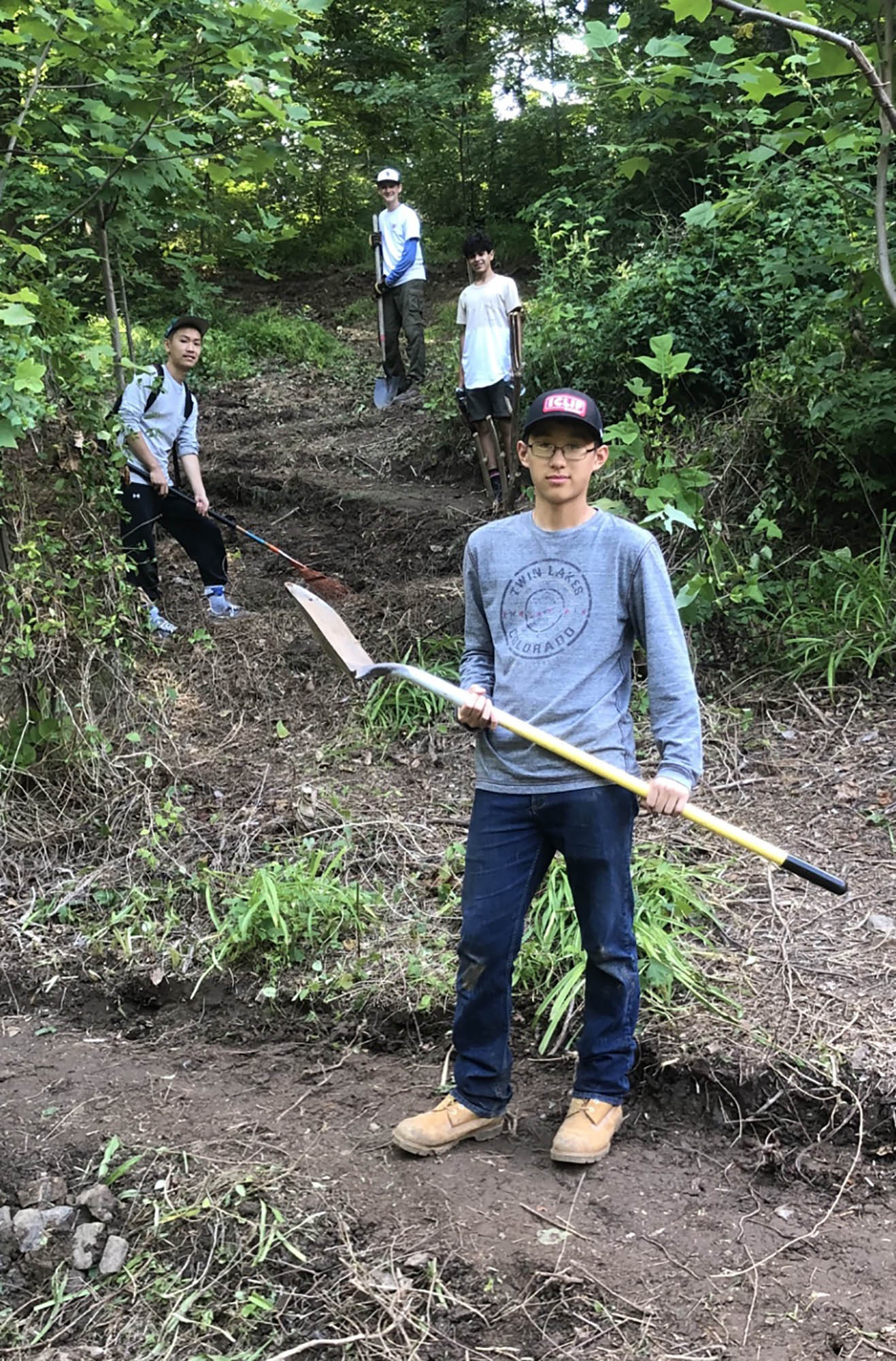 Gabriel Ma (front) worked recently on a switchback trail with friend Andrew Huang (left) and fellow Boy Scouts including Jack Henry (left at top) and Jack Santee (right at top.)  Photo by Lee Hoffman.