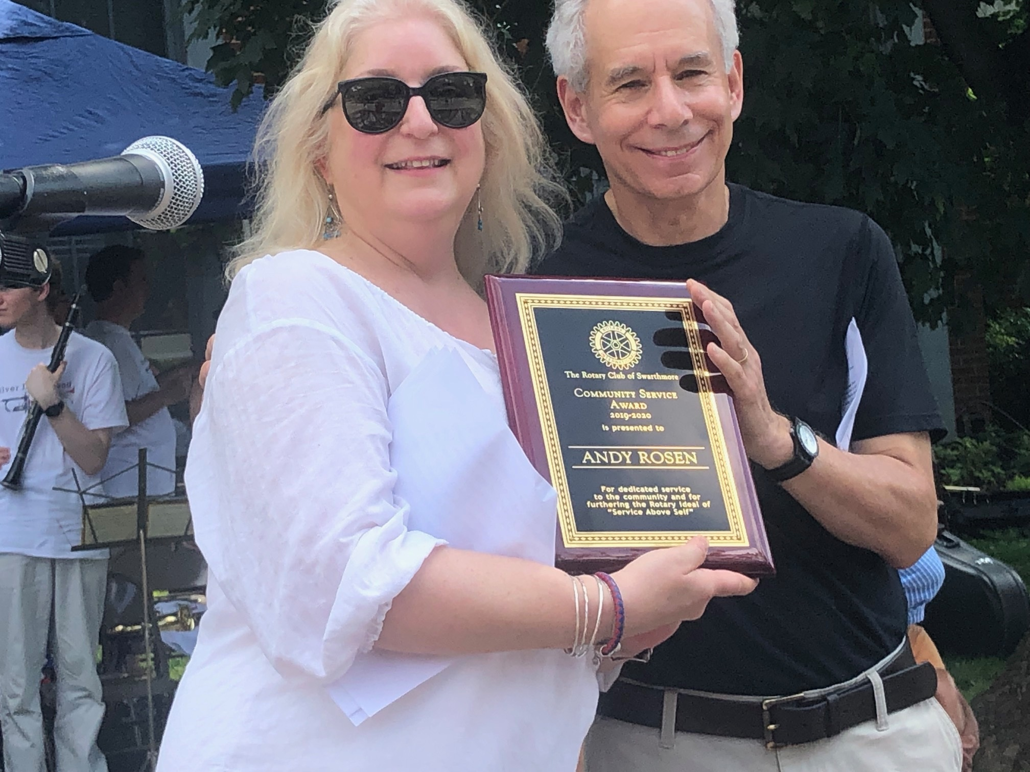 Swarthmore Rotary President Maria Zissimos presents Andy Rosen a Community Service Award