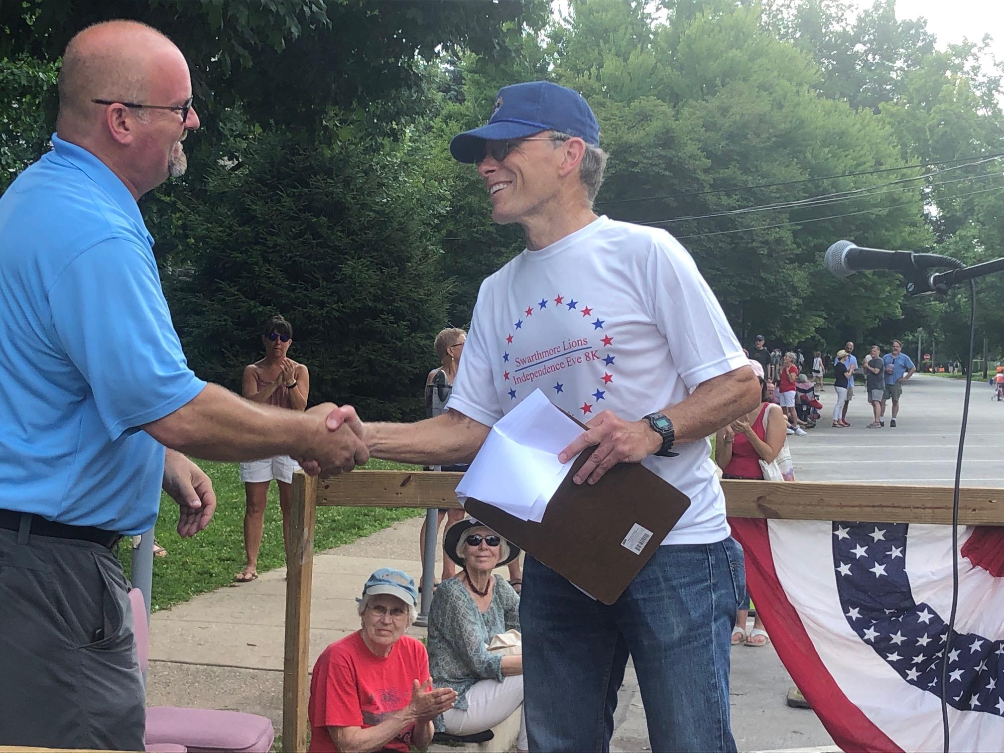 Swarthmorean  co-owner Rob Borgstrom receiving his Lions Club award