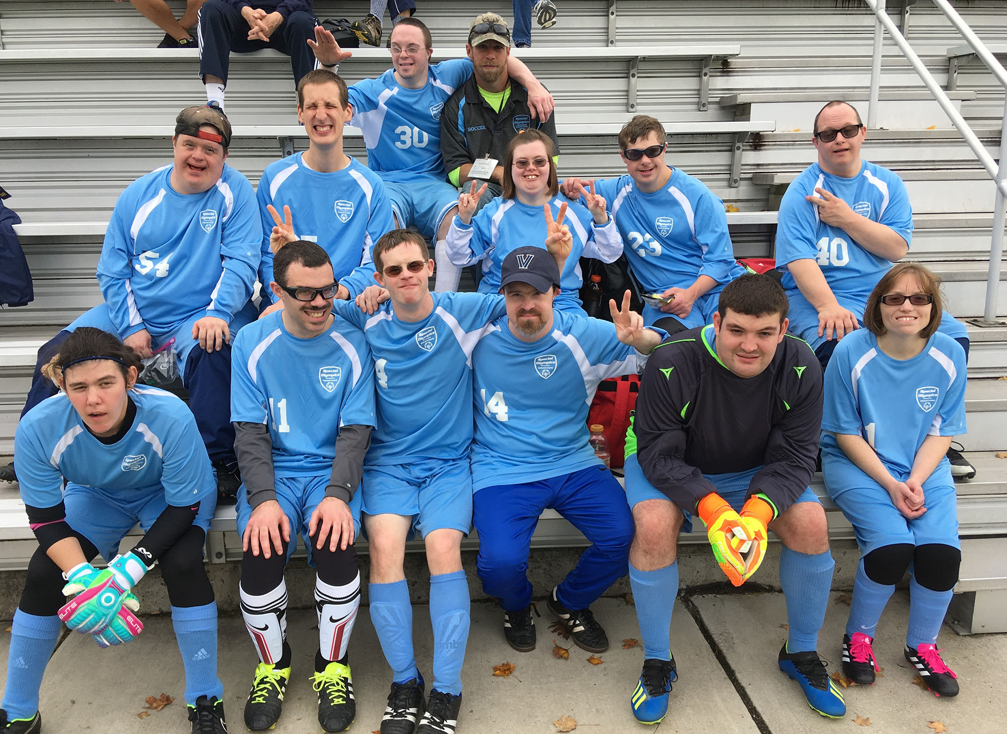 "Clair Duffy (front row, left) was a goalkeeper and utility player for this Delaware County soccer team, one of several Delco squads which won titles in the 2018 Pennsylvania Special Olympics championships. Clair's favorite sport is actually softball, which she has played avidly since she was a kid (she's 32 now), said her mother Jane Duffy of Wallingford. Now the summer season is coming to a close, it's time to get ready for the fall soccer campaign, Jane said. ""Clair has a good time, whatever the sport. It's a great opportunity for her to socialize with other adults."" A product of the Wallingford-Swarthmore School District, Clair was a member of the Strath Haven marching band. Parents Jane and John Duffy plan to cheer her 7 x 7 soccer team on through the 2019 season, culminating in the Pennsylvania Special Olympics, to be held at Villanova University."