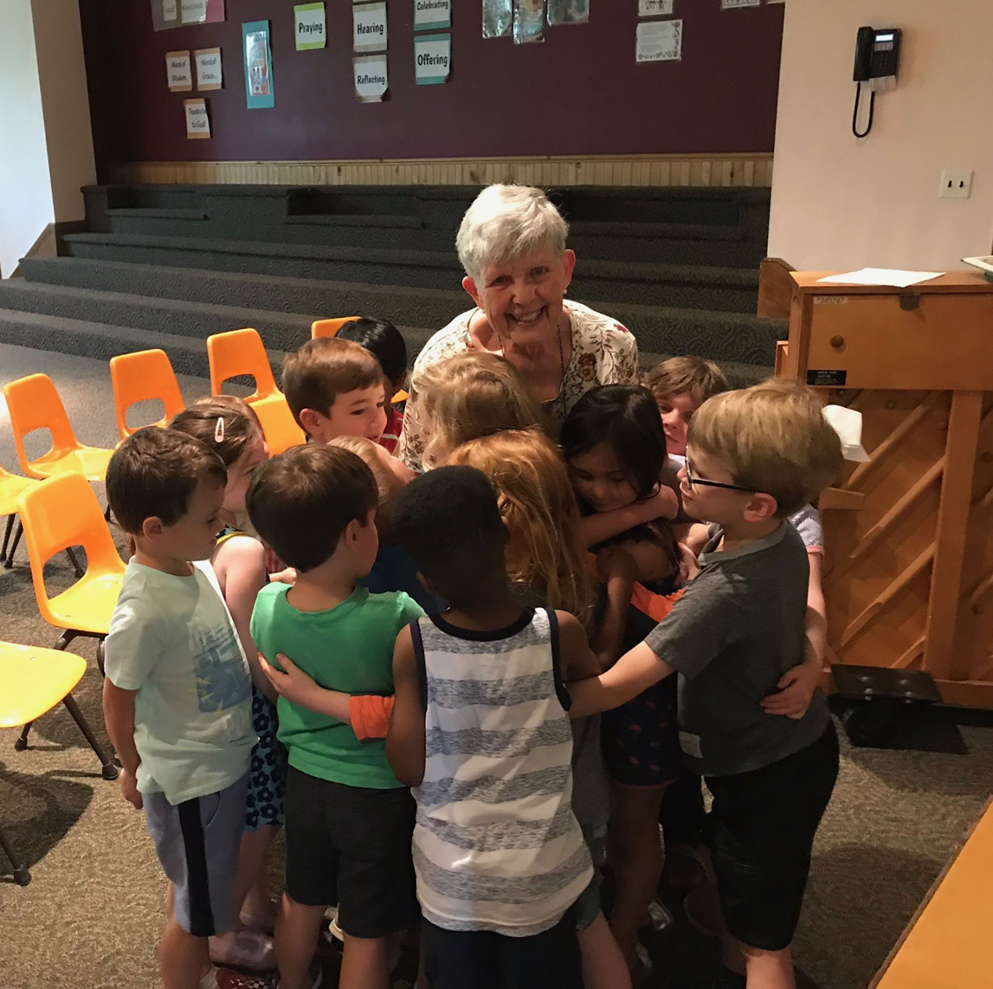 Joyce Perry and students in the music room of Swarthmore Presbyterian Nursery Day School, May 2019.