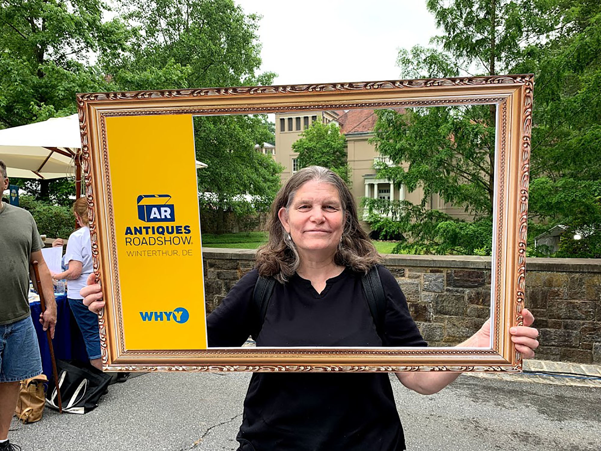 """Elizabeth Vogdes with her Antiques Roadshow souvenir. She pointed out that """"Clearly SOMEONE was allowed to take photos — see ' Behind the Scenes of Season 24 ' on the Antiques Roadshow Website."""