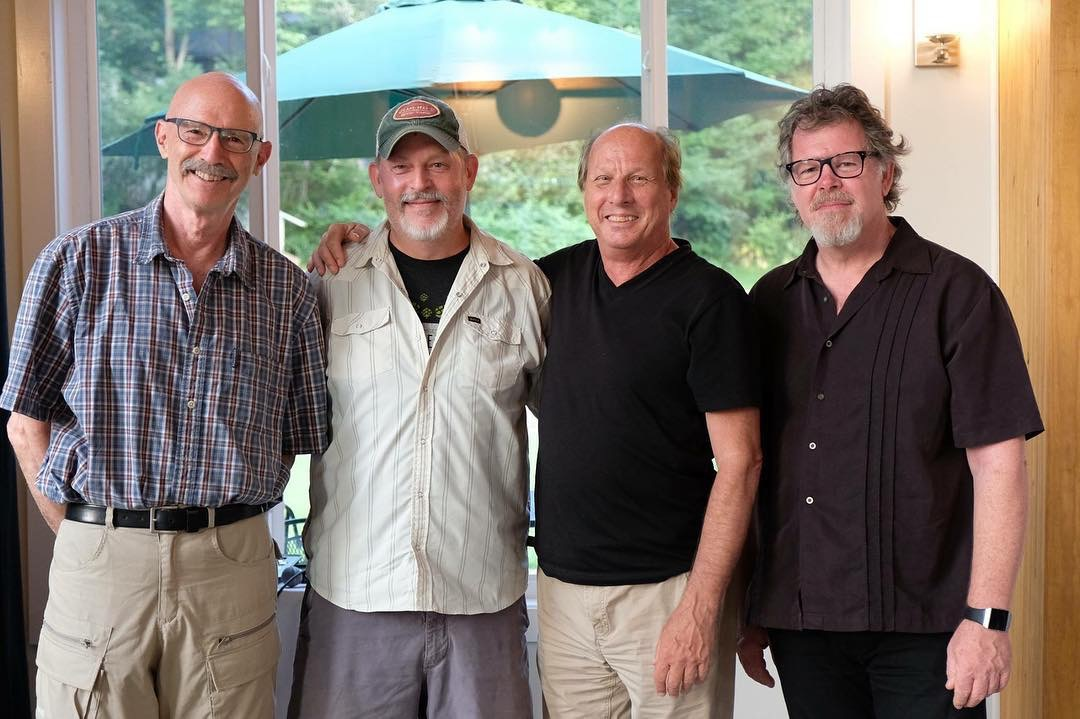 Greg Hoy (2nd from left) pinches himself as he hangs with Tony Levin (left), Adrian Belew (second from right) and Pat Mastellotto (right).  Photo by Avraham Bank.
