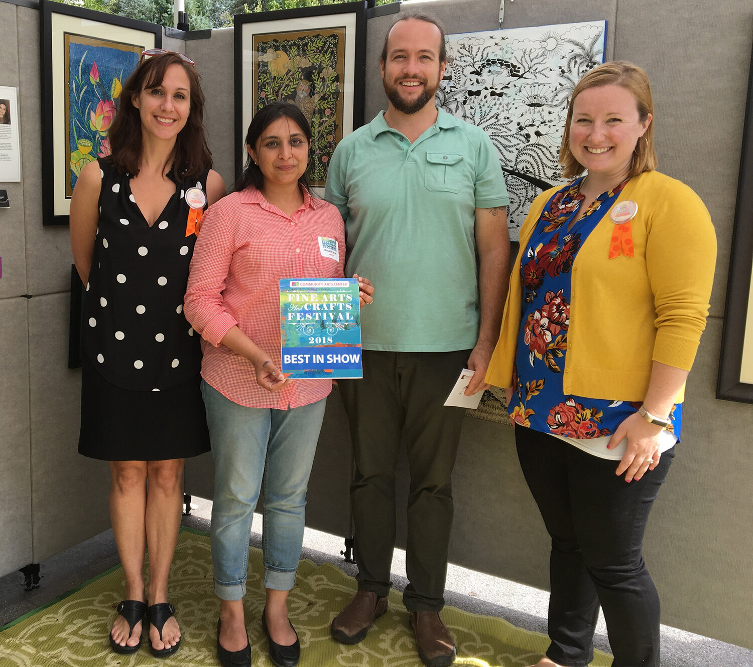 Local artist Rinal Parikh of Wallingford was presented with the Best Show prize by CAC Executive Director Paul Downie and festival judges Susanna Gold and Caitlin Flaherty at the 2018 Fine Arts and Crafts Festival.