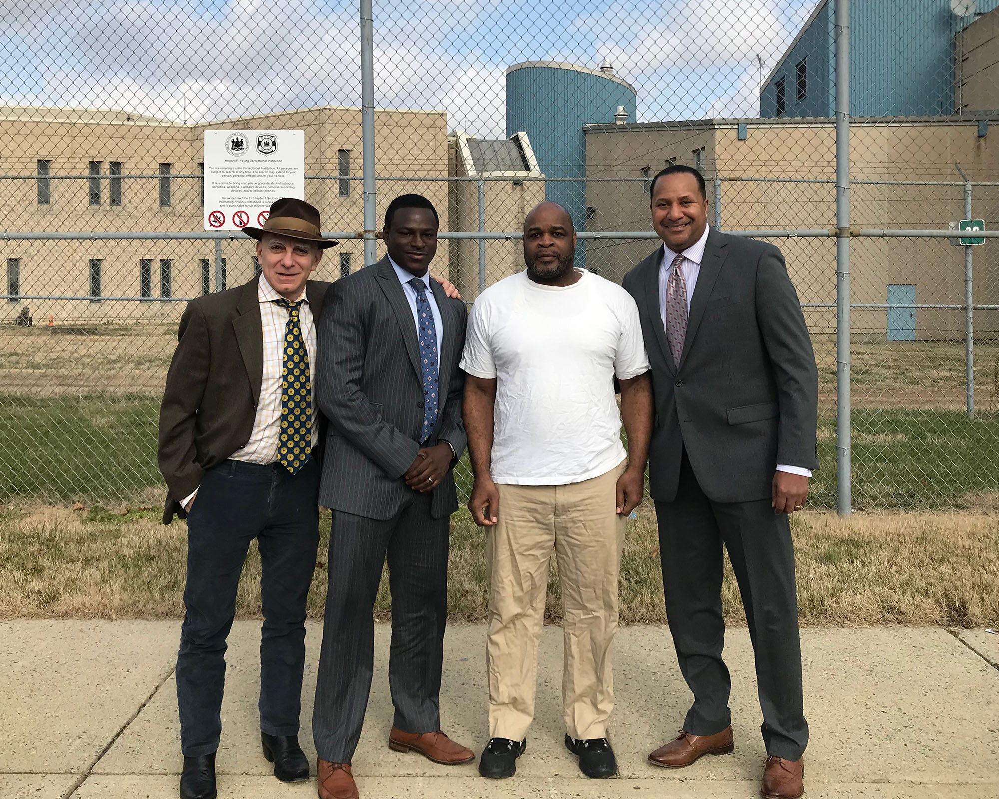 Elmer Daniels (2nd from right) was released from a Delaware prison last year, with assistance from (L to R) attorney Herb Mondros, lead attorney Emeka Igwe, and lead investigator Terence Jones.