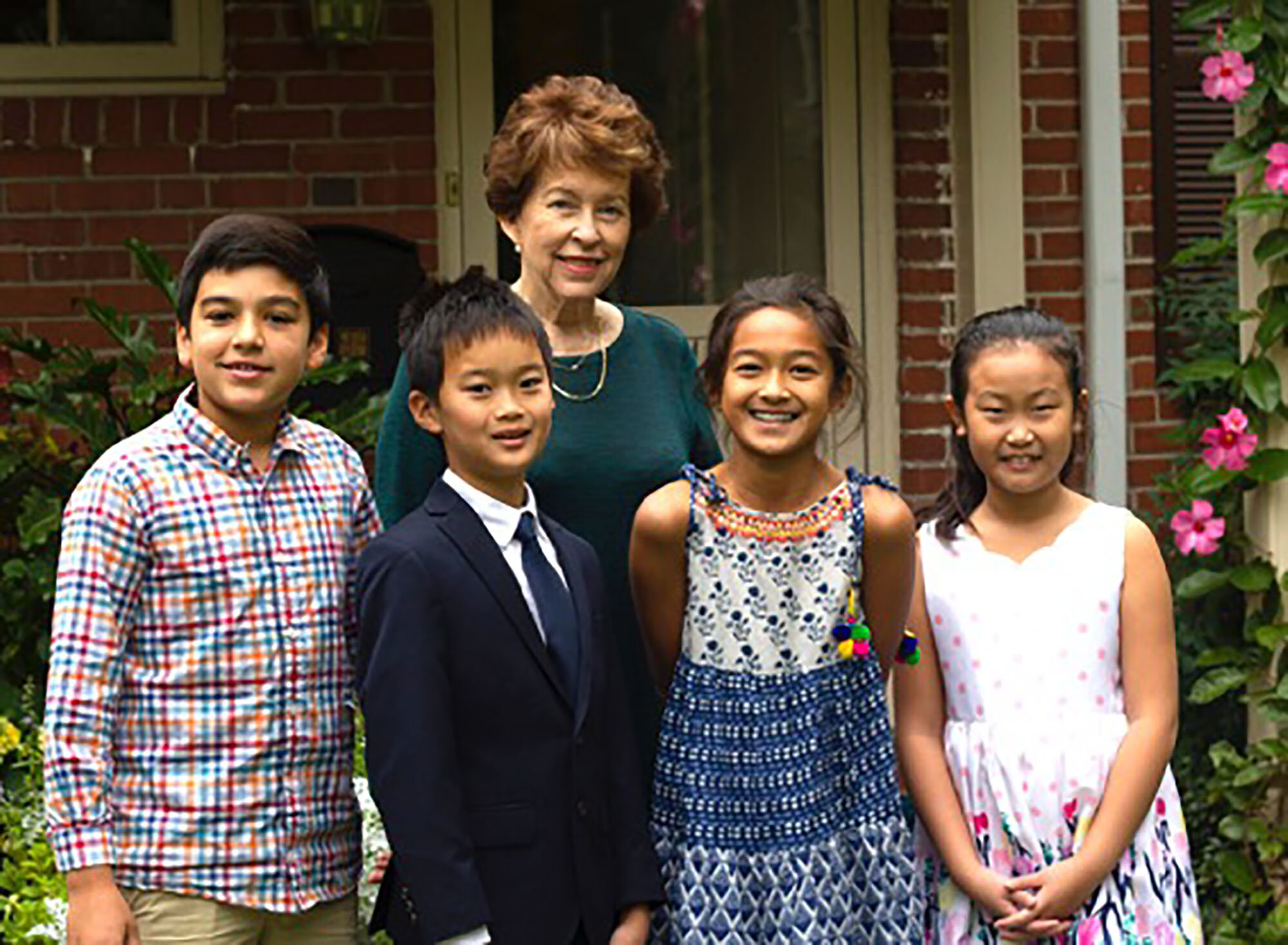 Piano teacher Donna Kay Jones stands behind her students (left to right) Ted Clark, Vincent Zhu, Daksha Nair, and Shannon Yue.