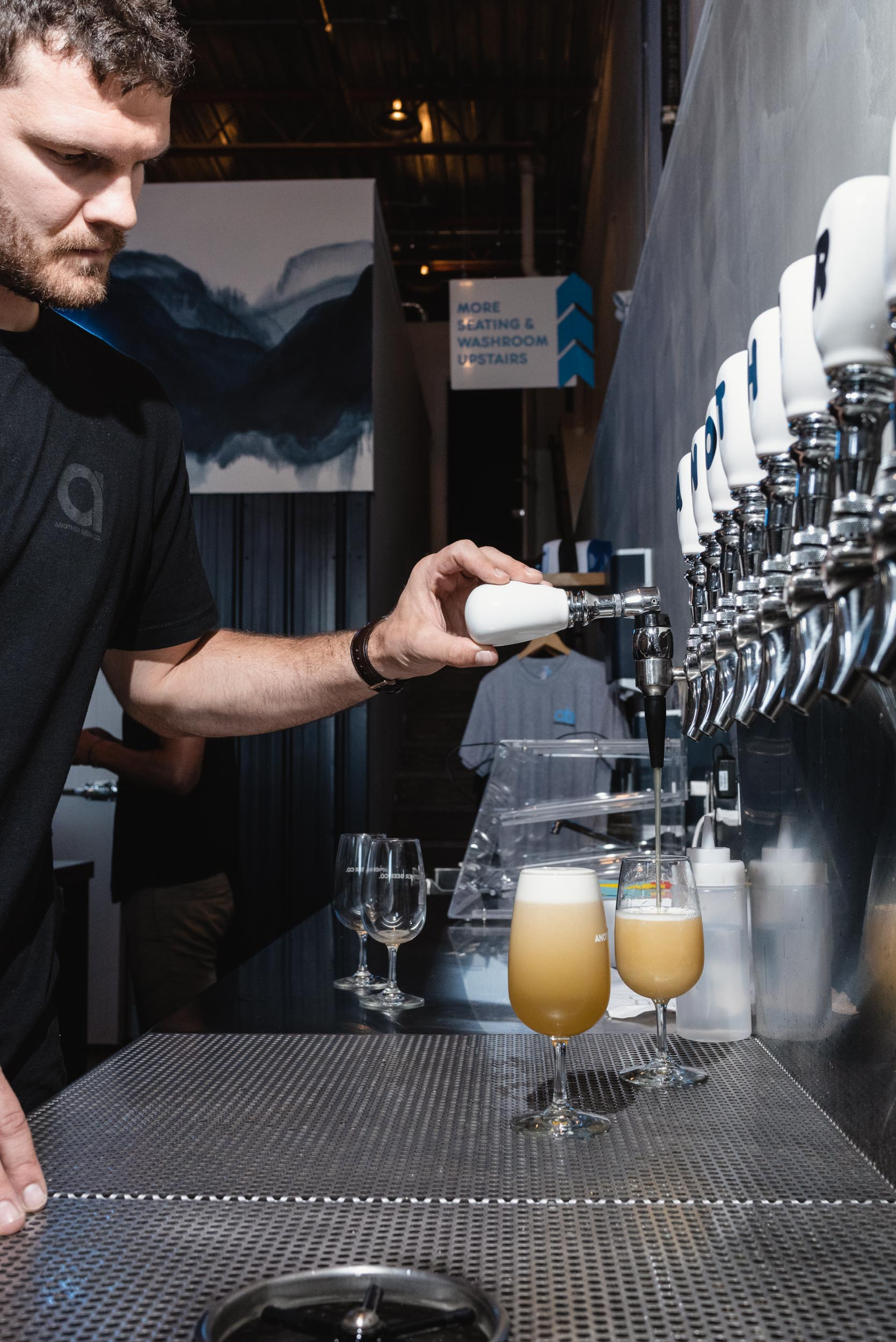 Clete Hanson pouring nitro IPA at Another Beer Company