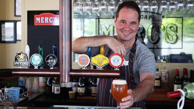 Paul at Merc's serving beer.jpg