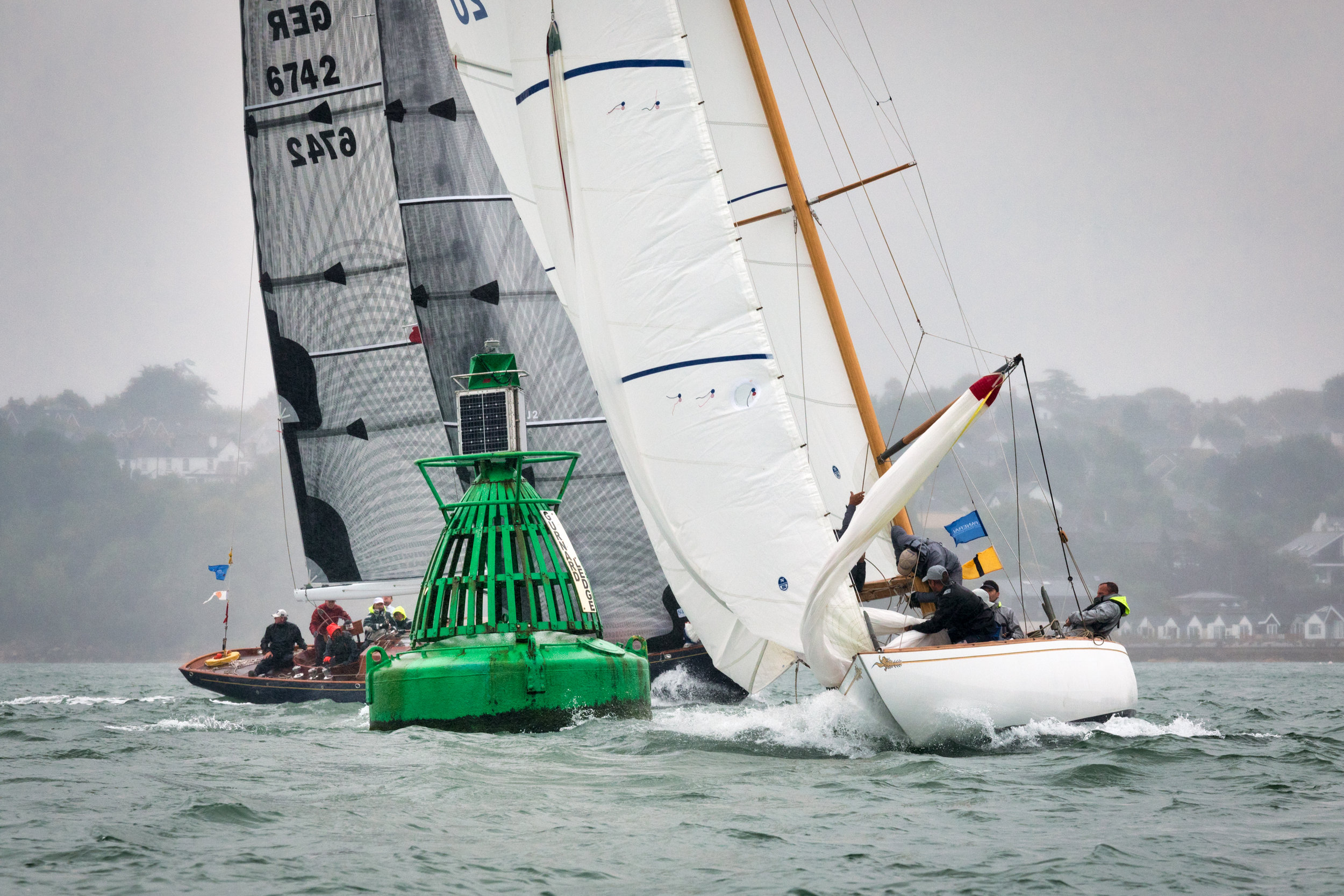 Challenging mark rounding and spinnaker hoists in heavy winds