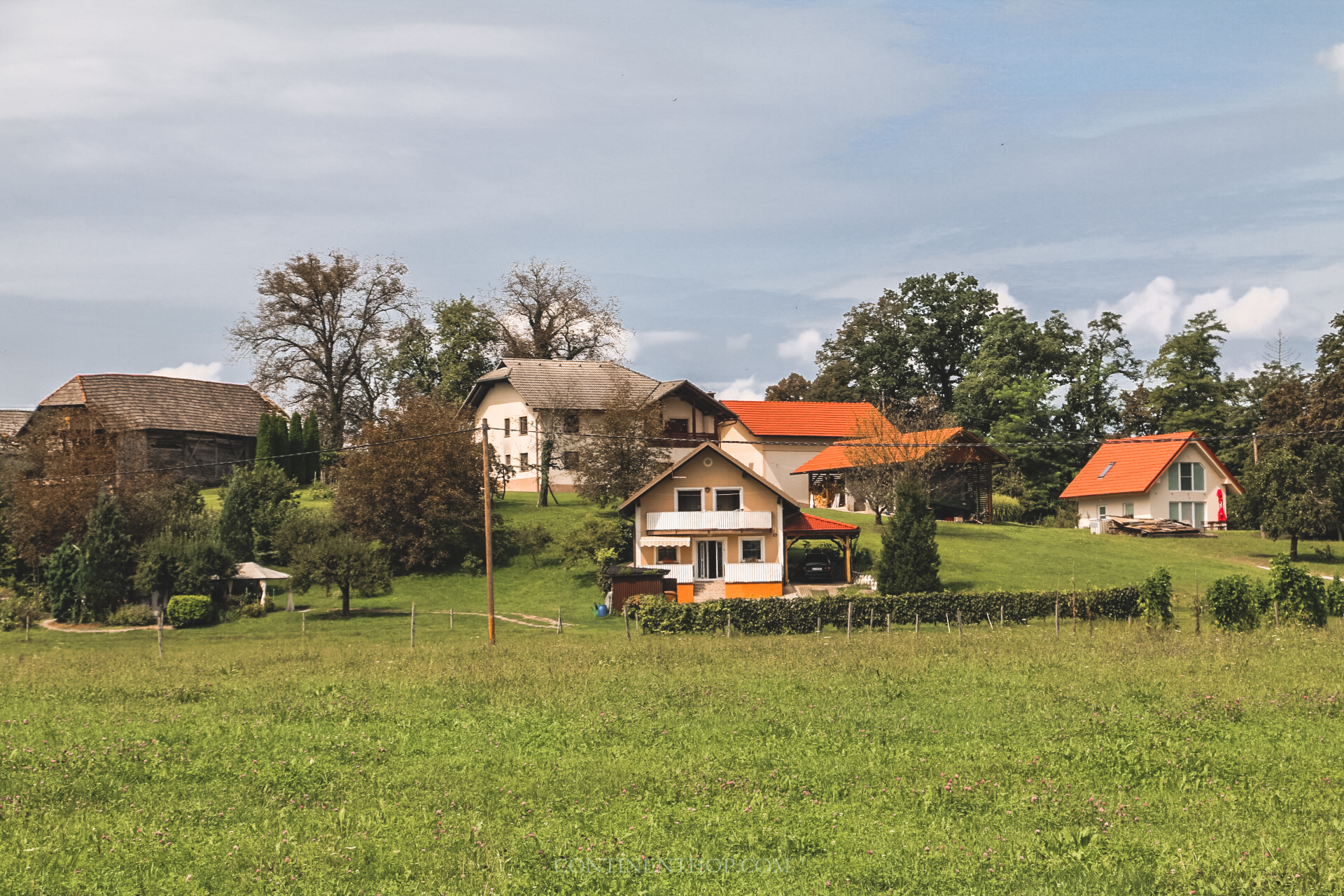 houses in front of luxury glamping huts at big berry resort in bela krajina slovenia