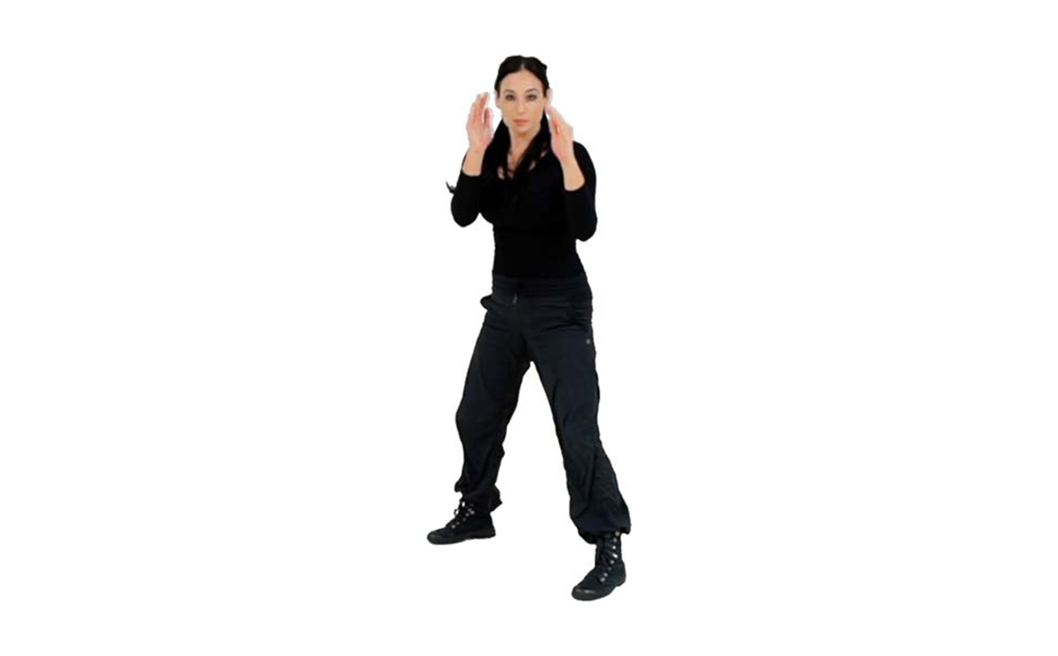 Step 4 - Once your foot is flat on the ground, raise your chest to return to your full Survival Stance with both hands protecting your face, and ready to engage in combatives or to run and escape.