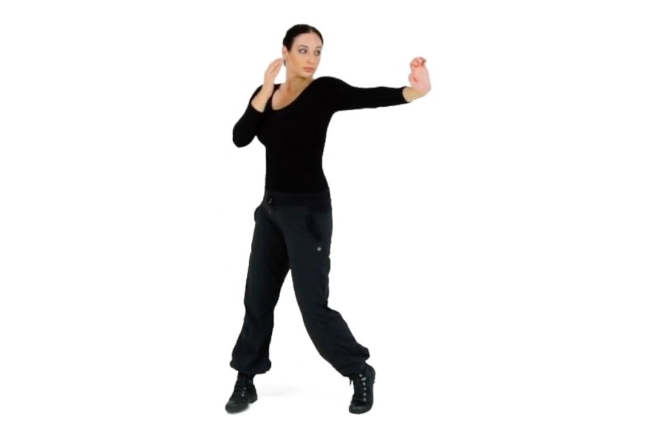 Step 2 (Front) - Curl the fingers back, flex the striking hand's wrist so you expose the heel of that palm. Continue to extend your arm until your elbow is slightly bent and make sure you engage that powerful Combative Twist behind the movement to maximize the power that you are generating.