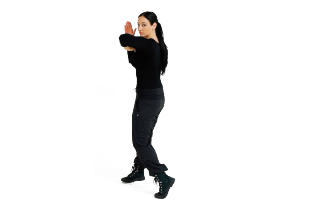 Step 3 (Front) - Complete the Combative Twist, pivoting your front foot, to drive your elbow through the target.