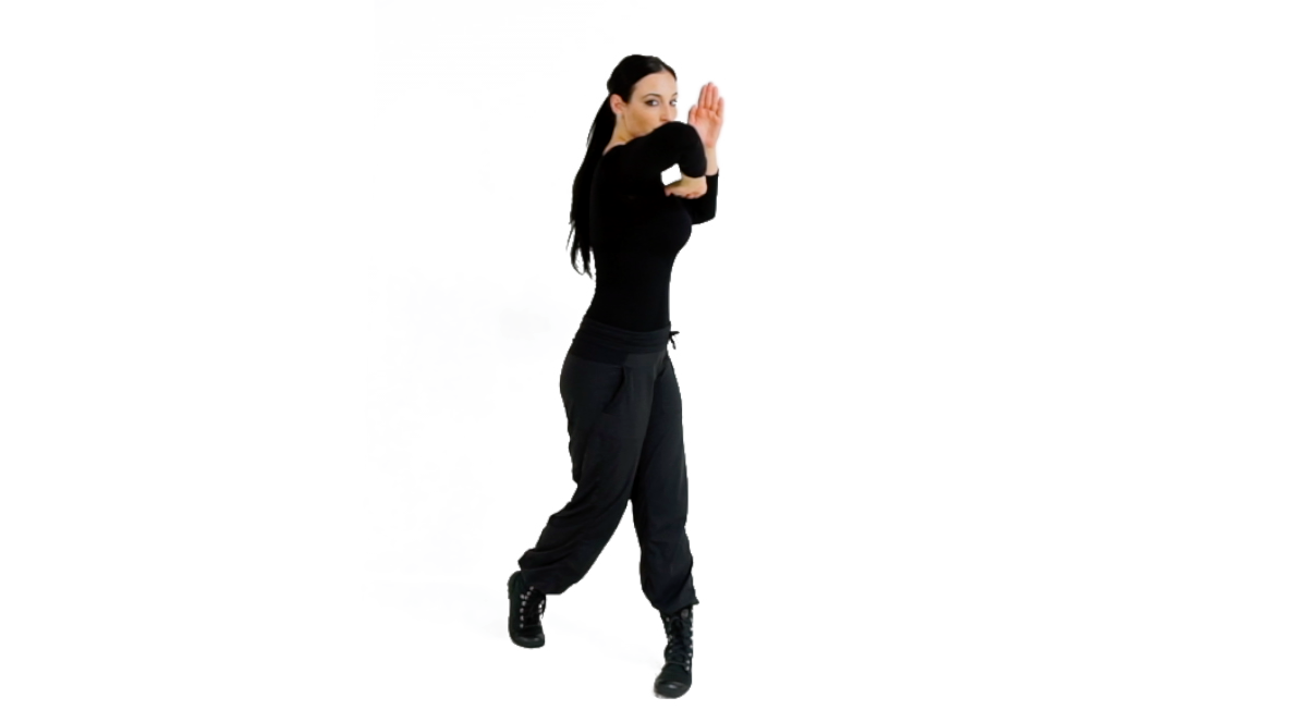 Step 3 (BACK) - Complete the Combative Twist, pivoting on your rear foot, to drive your elbow through the target.